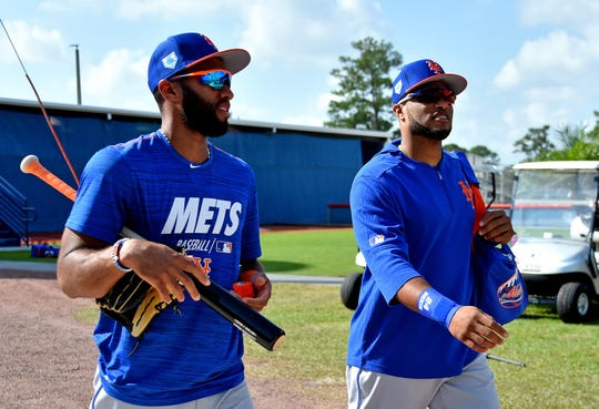 Feb 18, 2019; Port St. Lucie, FL, USA; New York Mets shortstop Amed Rosario (left) walks with teammate Robinson Cano (right) at First Data Field. Mandatory Credit: Steve Mitchell-USA TODAY Sports