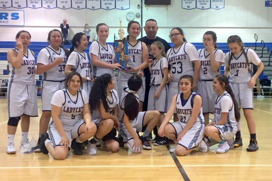 Red Mountain Middle School eighth-grade girls capped an undefeated season on the basketball and captured the post-season tournament championship in Socorro, NM on February 2, 2019. The Lady 'Cats finished 15-0 and also captured the Alamogordo round-robin tournament.