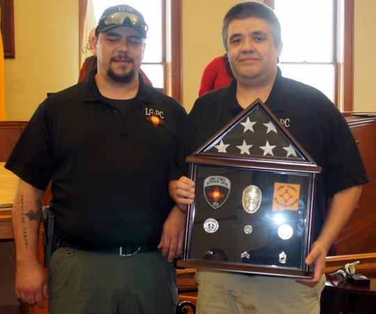Luna County Corrections Sgt. Pete Loya (right)retired from the Luna County Detention Center where here served the past 25 years. Loya was presented with a shadow box commemorating his 25 years of service to the county as a parting gift. LCDC Lt. Andy Gilmore (left) presented the gift during a service awards presentation at Thursday's Luna County Board of Commissioners meeting.