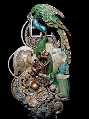 A jewelry piece by artist Lisa Carlson