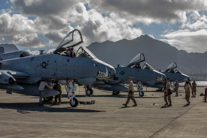 U.S. Airmen assigned to the 442nd Fighter Wing from Whiteman Air Force Base, Missouri, secure and prepare A-10 Thunderbolt II aircraft after arriving aboard Marine Corps Air Station Kaneohe Bay, Marine Corps Base Hawaii, Feb. 11, 2019. The unit will be participating in various training exercises across the Hawaiian islands, working alongside U.S. Marine Corps units.