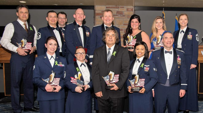 2018 annual award winners pose for a photo, Feb. 9, 2019, on Holloman Air Force Base, N.M. During the banquet, 14 Holloman Airmen received awards for their outstanding performance throughout the year.