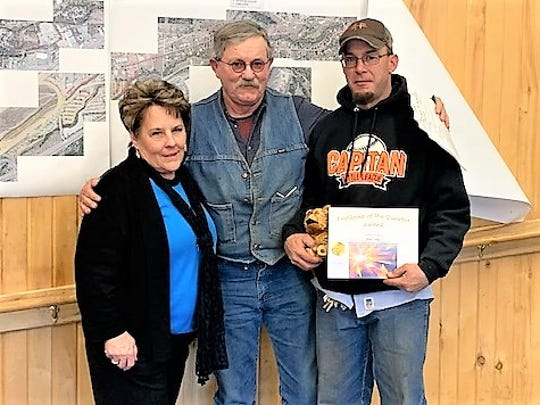 Josh Long, at right, received the public works award from Street Department director Fred Payton and Village Manager Debi Lee.