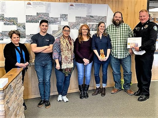 Ruidoso dispatchers were honored bor the quarter by Village Manager Debi Lee, at left, and Police Chief Darren Hooker, at right.