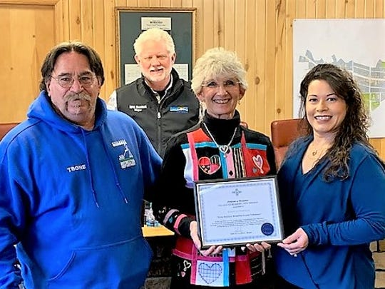 Ruidoso Councilor Susan Lutterman, center, received an award for her volunteer work with Keep Ruidoso Beautiful from David Tetreault of Parks and Recreation and KRB committee chairman Reyna Flores. In back is Mayor Lynn Crawford.