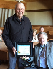 George Mader, standing, recently received a certificate of recognition and appreciation for leading the Strong Bones exercise class three times a week for more than two years. His commitment and dedication has been recognized by First Christian Church, the Ruidoso community and the class.