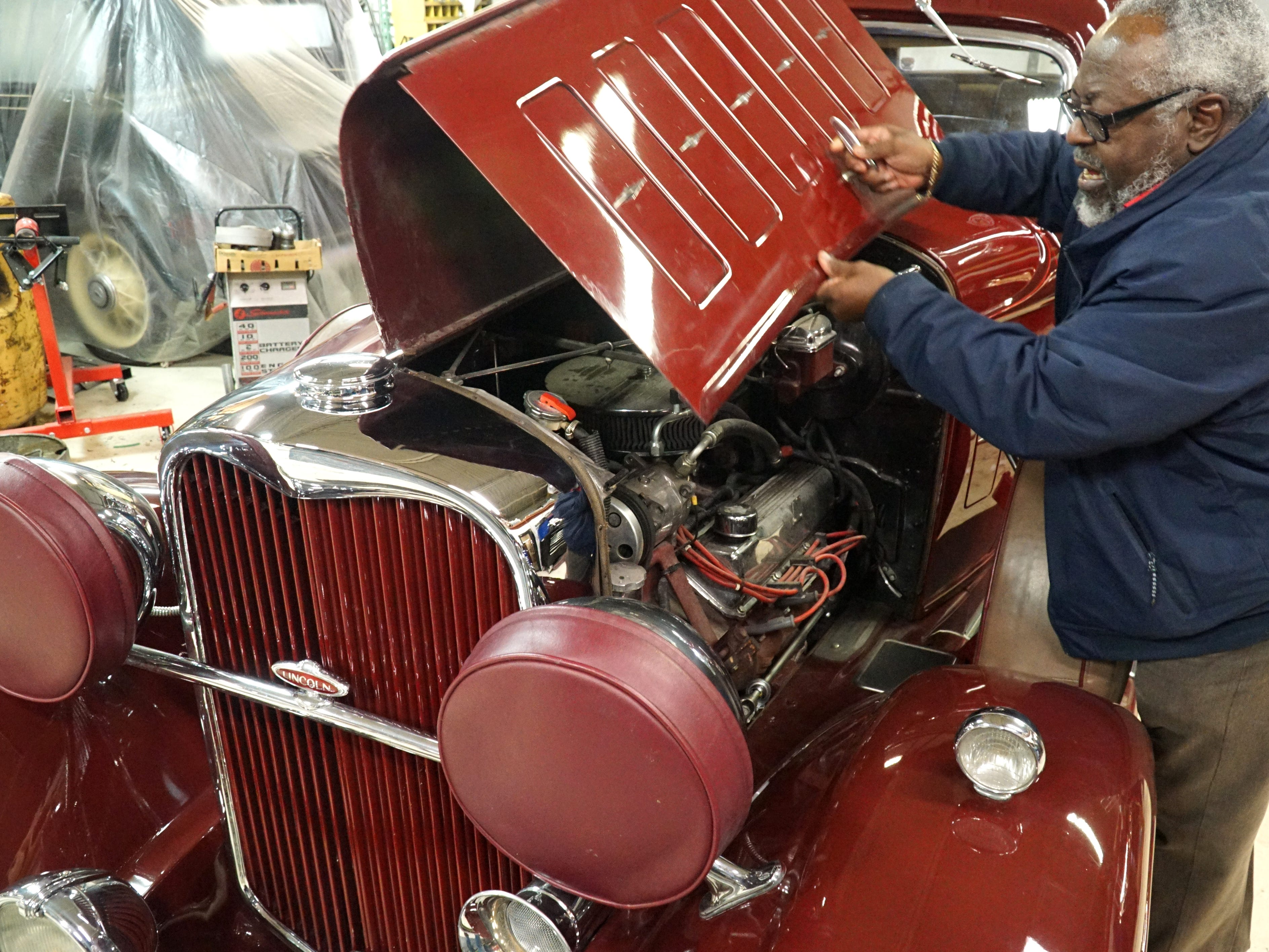Fred Neal opens up the engine compartment of his '32 Lincoln.