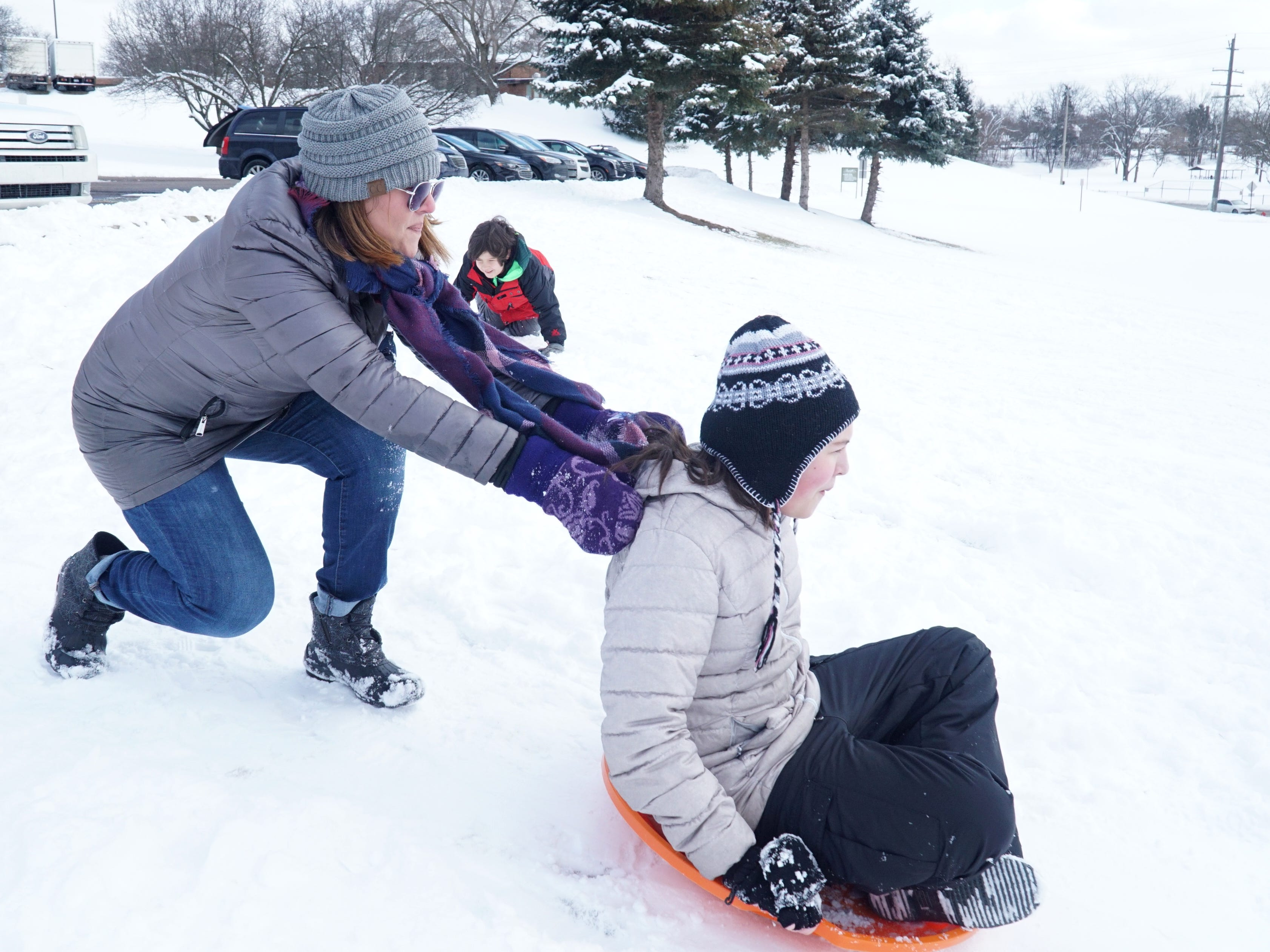 Jenna Latimer launches her daughter Emma, 12, off the top of the hill off Shiawasee on Feb. 18.