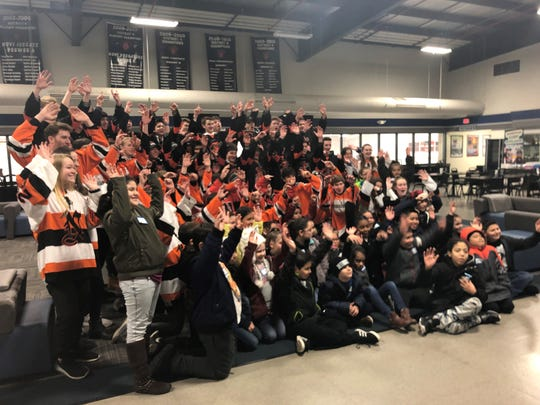 Northville High School hockey players and fourth graders from Neinas Dual Language Academy in Detroit made a connection Feb. 13, 2019 at Novi Ice Arena.