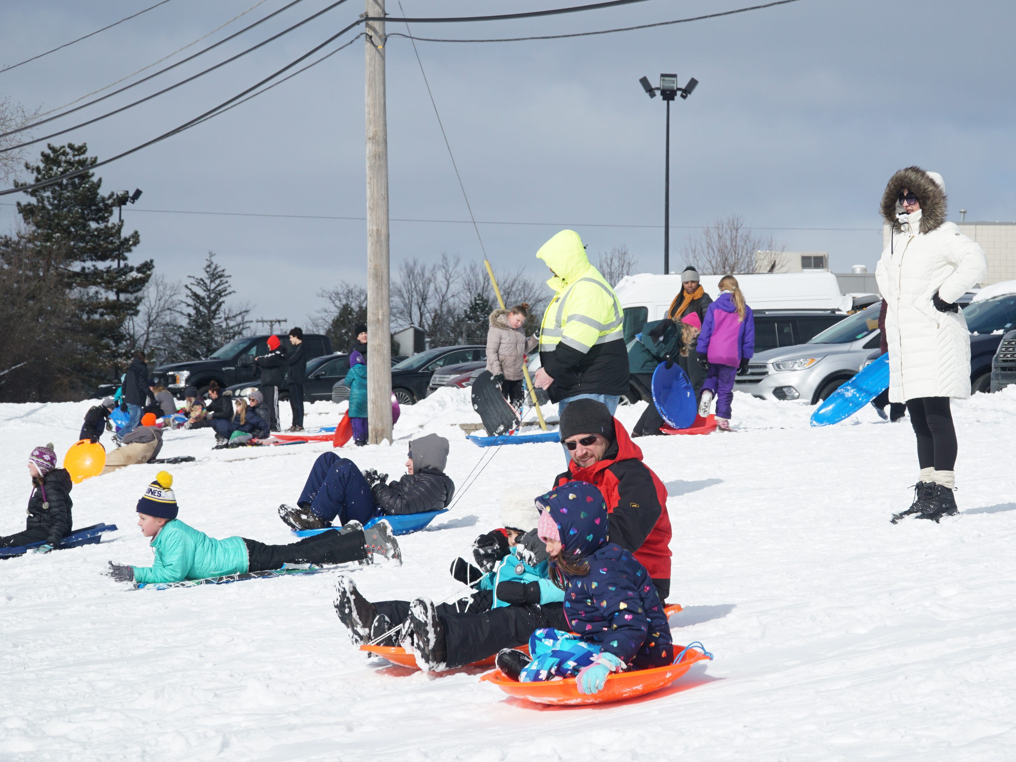 Dozens of snow-lovers hit the incline of Farmington's Sled Hill off Shiawasee on Feb. 18. About five inches of powdery white stuff the previous day made for great sledding.