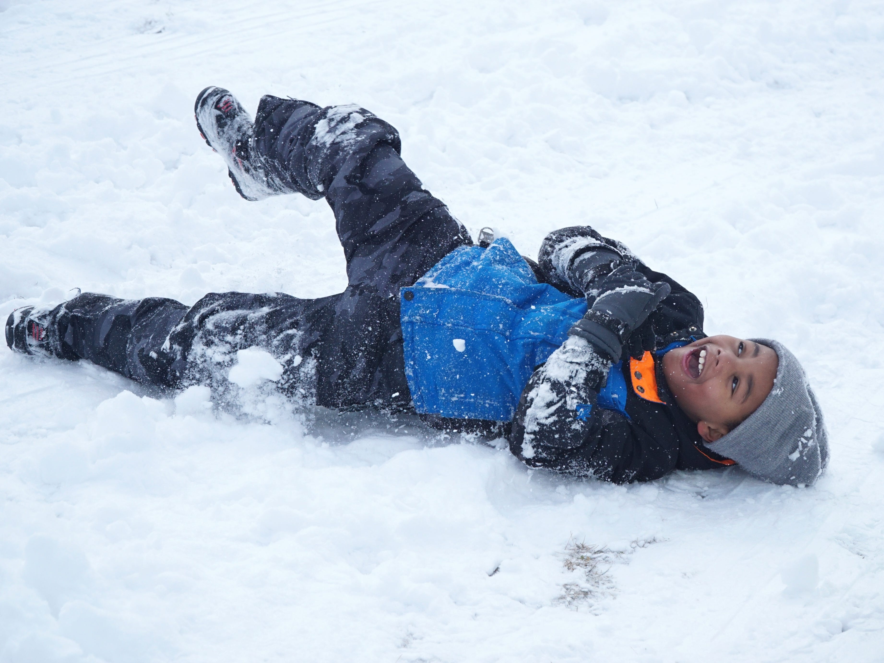 Elijah Marbry goes sled-less as he tumbles down the hill in Farmington off Shiawasee on Feb. 18. Marbry was there with his mom and young sister - enjoying a day off school.