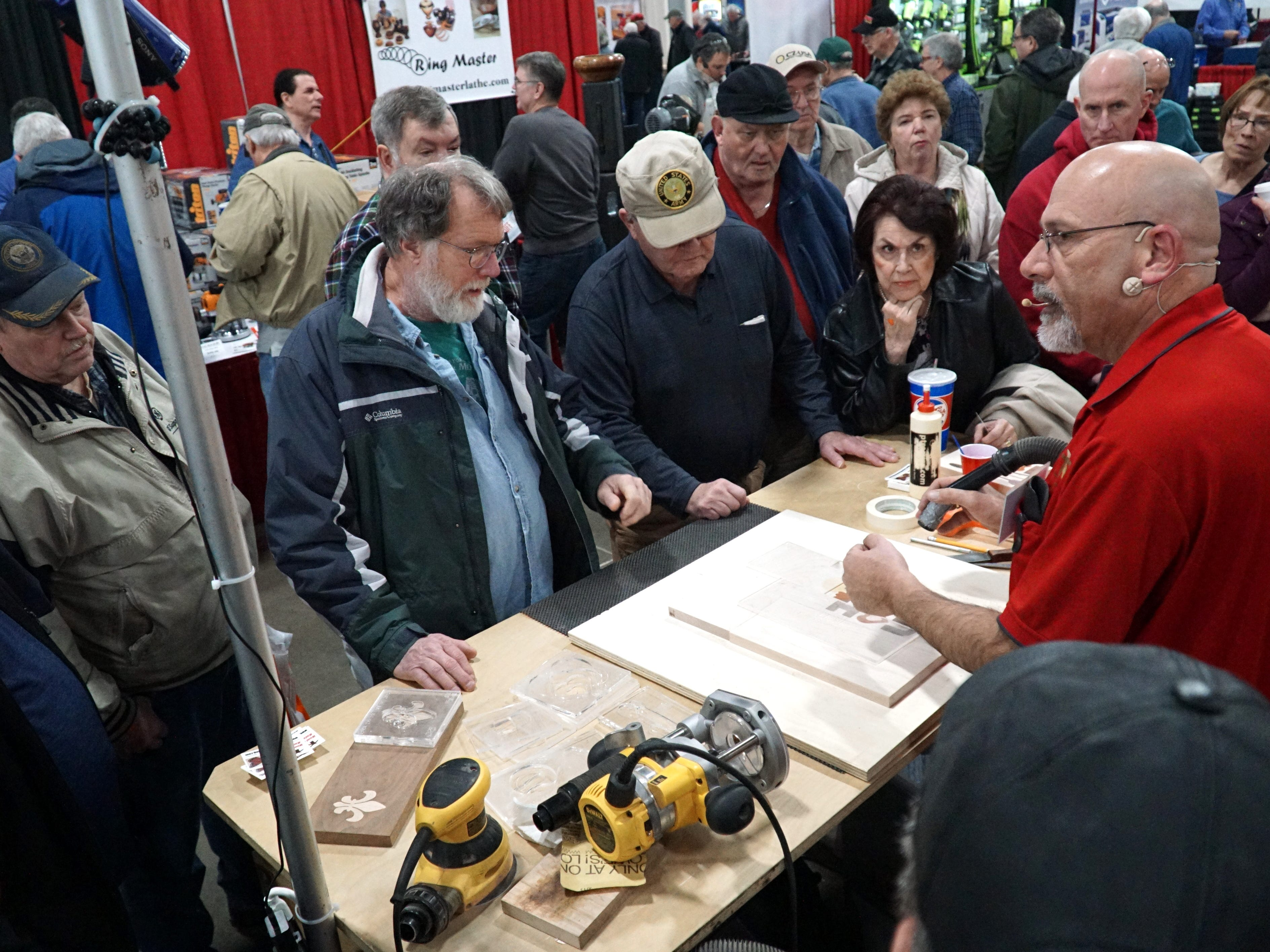 Larry Tarter demonstrates some wood inlay techniques at the Feb.15 Michigan Wood Working Show at Novi's Suburban Collection Showplace.