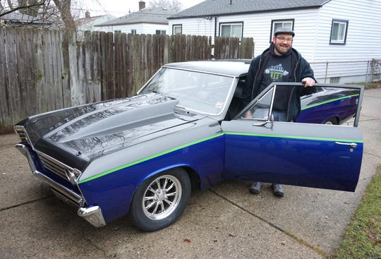 Jamey Carey poses with his '67 Chevy at his Westland home. Carey will be showing the car at this year's Autorama in Detroit from March 1-3. Carey's car is painted in the colors of Michigan's Donate Life campaign and notes the date of Nov. 6, 2016 - when Carey received a double-lung transplant.