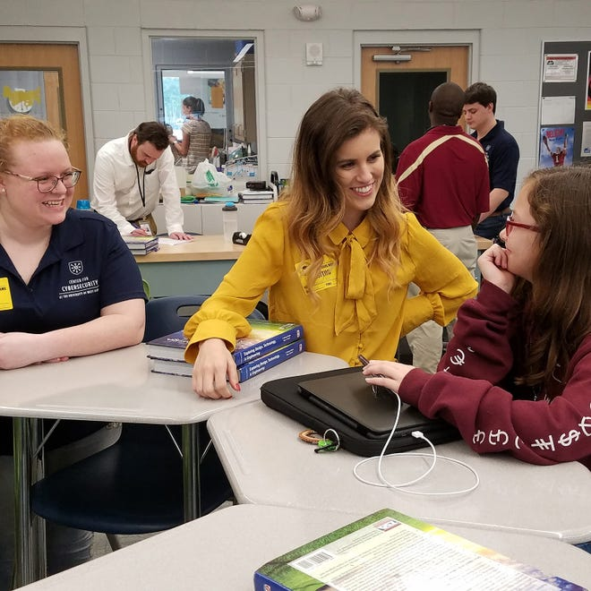 Cybersecurity ambassadors Megan Morton and Caroline Krouse answer cybersecurity questions from a Beulah Middle School student.