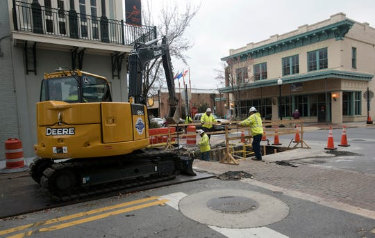 Contractors work in February on upgrading the underground utilities on Romana Street in downtown Pensacola.