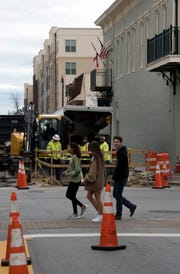 Electrical Contractors continue their work upgrading the underground utilities on Romana Street in downtown Pensacola on Monday, Feb. 18, 2019.