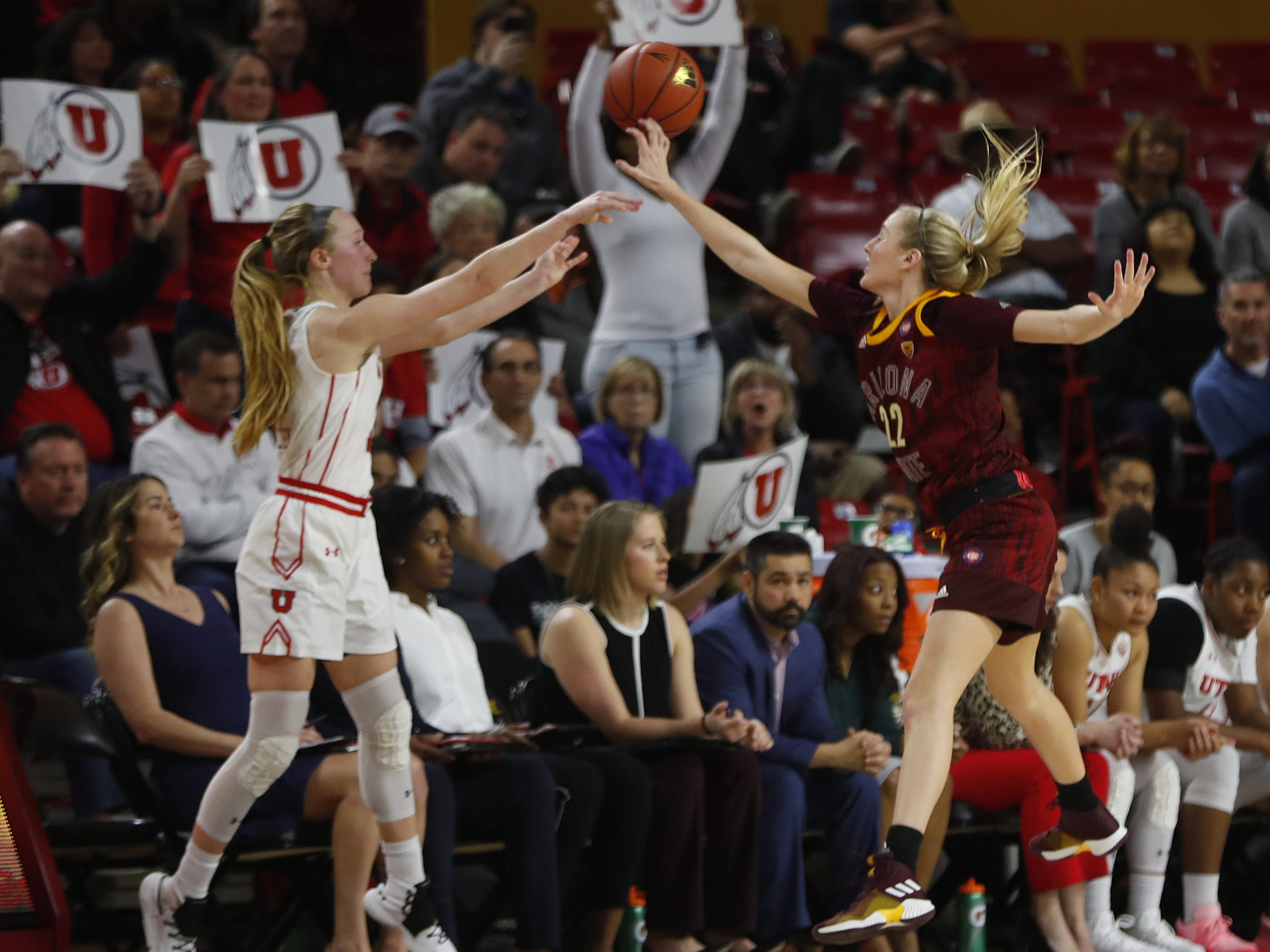 ASU's Courtney Ekmark (22) tips an inbound pass with 0.6 seconds remaining against Utah's Dru Gylten (10) during the second half at Wells Fargo Arena in Tempe, Ariz. on February 17, 2019.