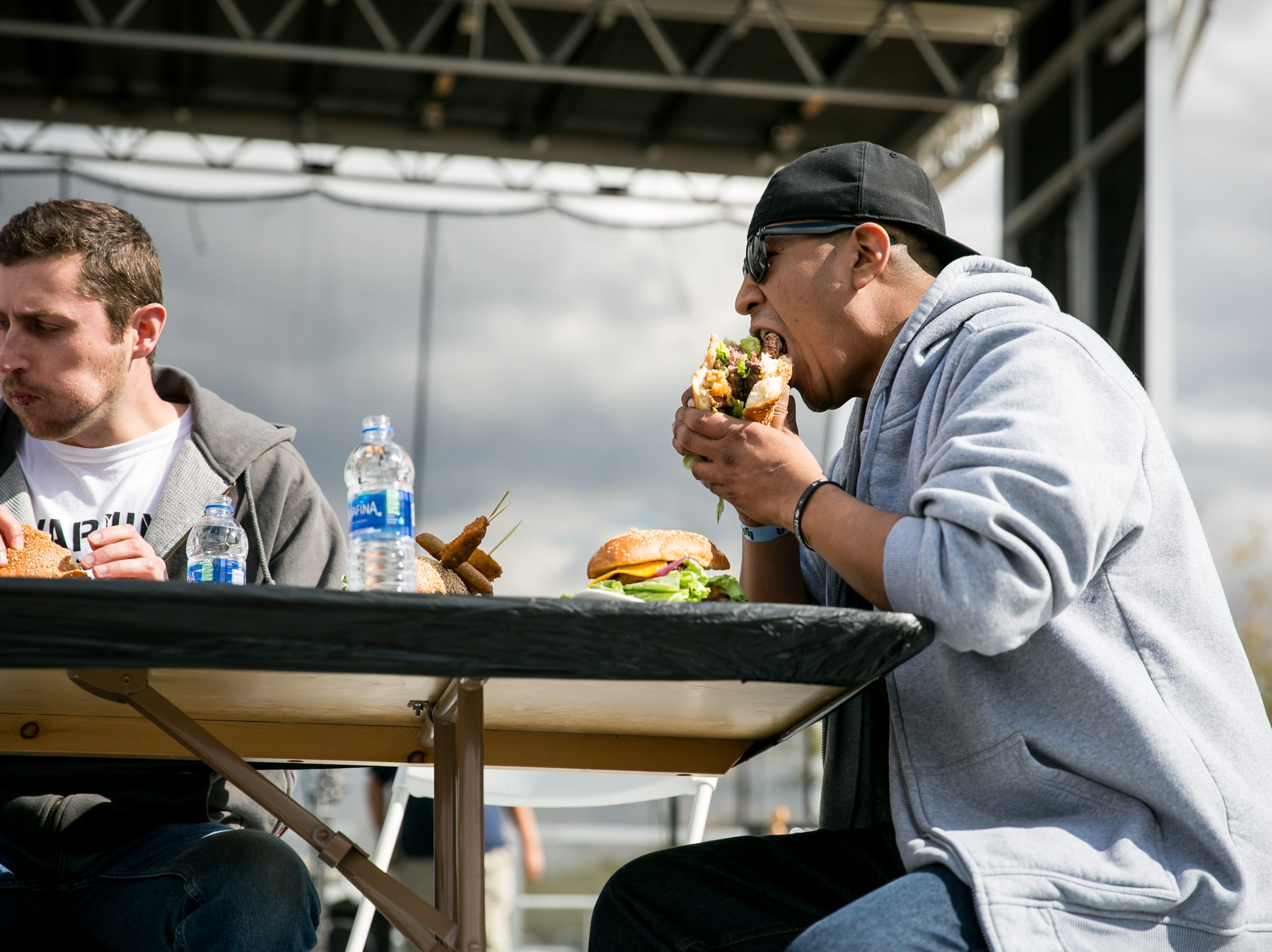 The burger eating contest was daunting during the Street Eats Food Truck Festival at Salt River Fields near Scottsdale on Feb. 17, 2019.