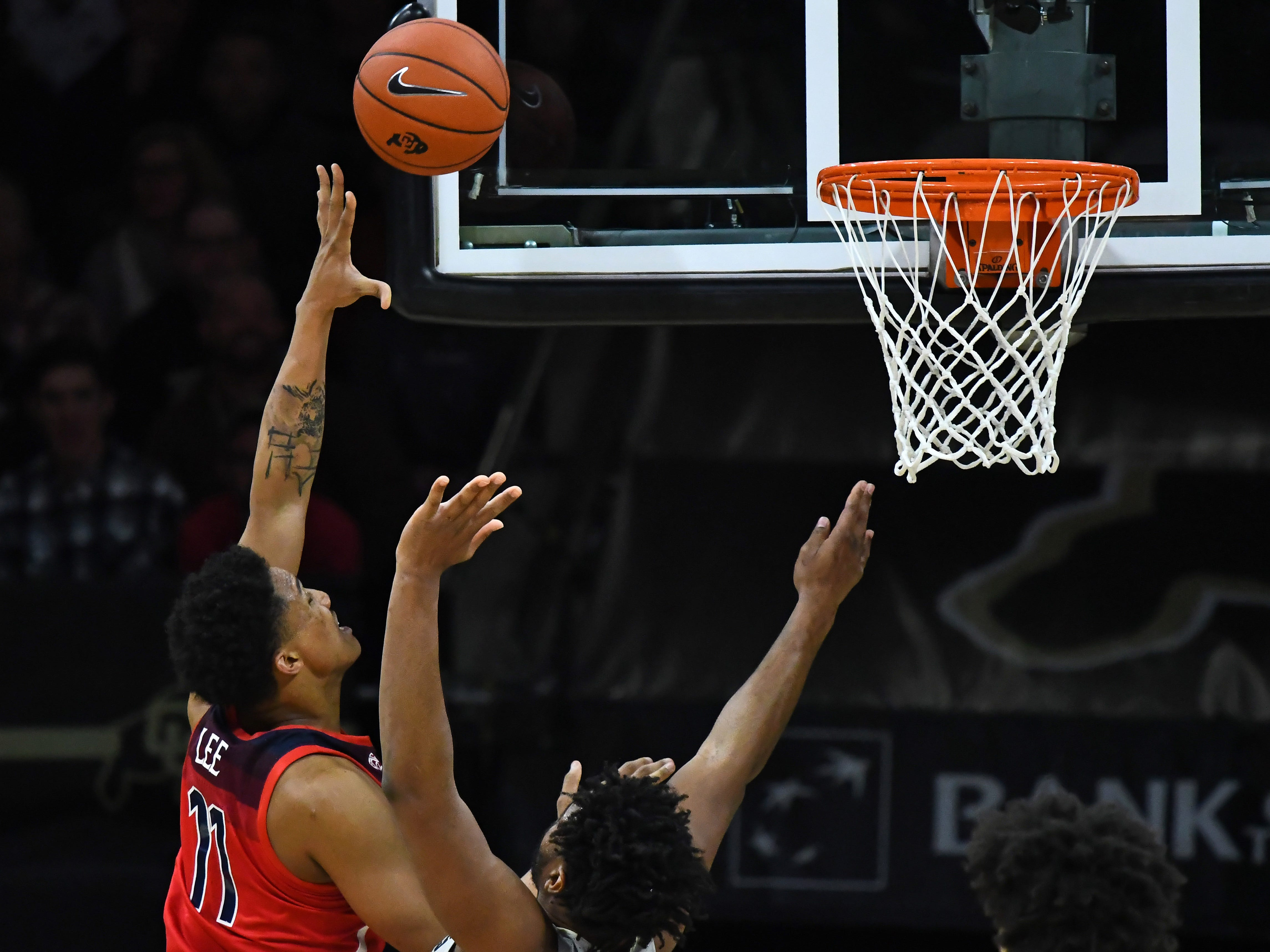 Feb 17, 2019; Boulder, CO, USA; Arizona Wildcats forward Ira Lee (11) shoots over Colorado Buffaloes forward Evan Battey (21) in the first half at the Coors Events Center. Mandatory Credit: Ron Chenoy-USA TODAY Sports