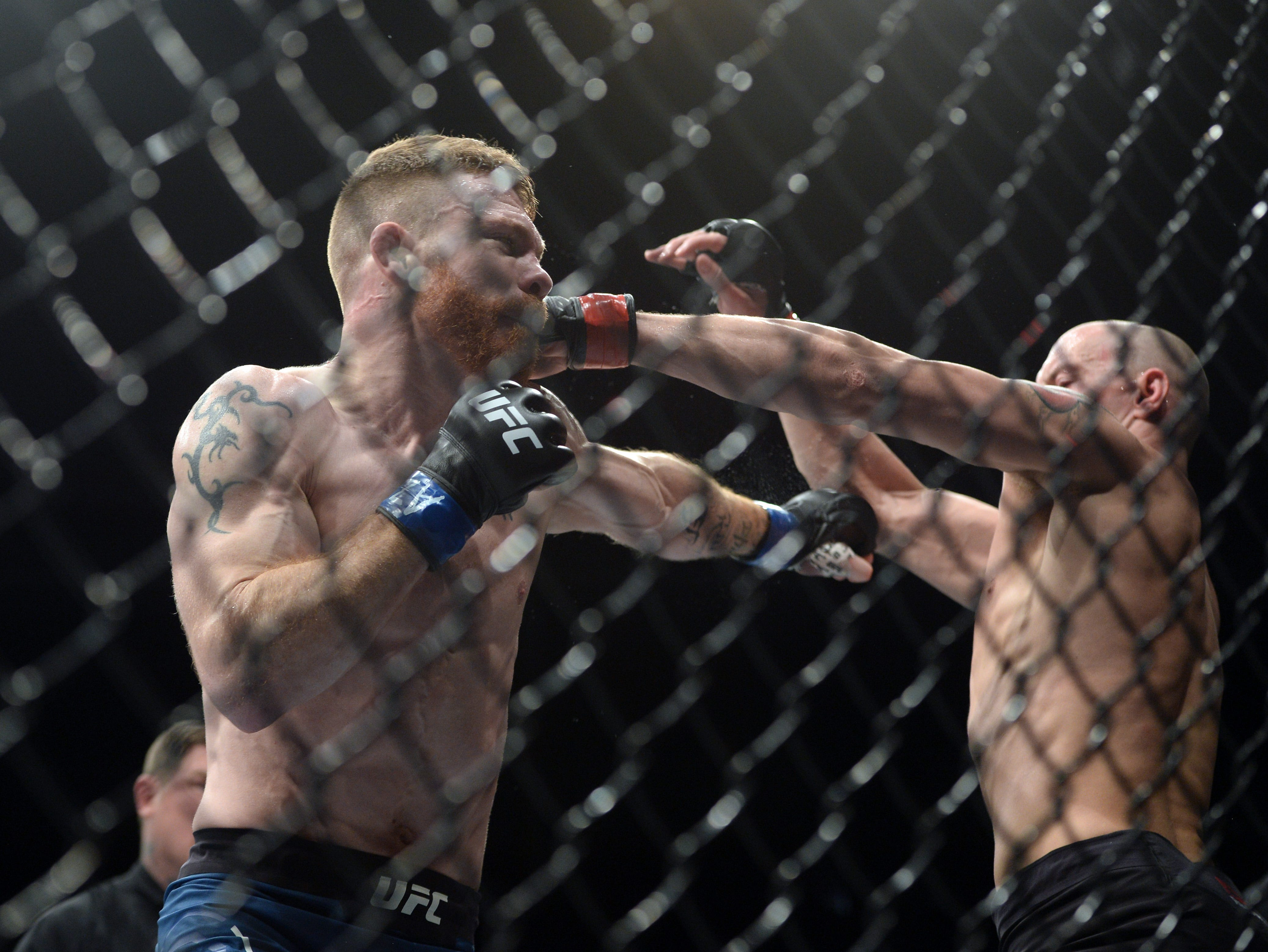 James Vick and Paul Felder exchange blows during their lightweight fight at Talking Stick Resort Arena.