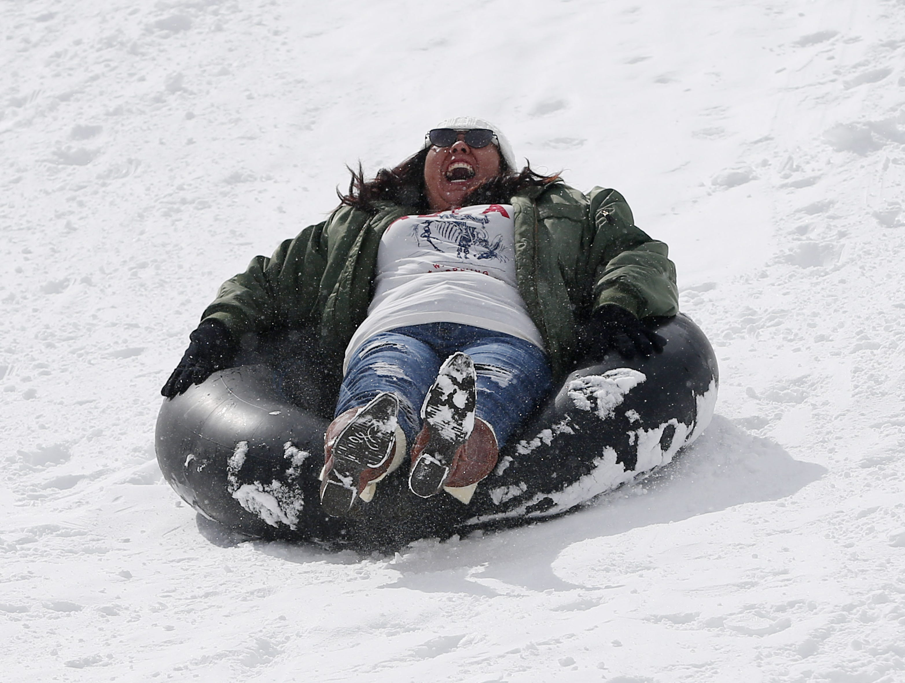 Melanie Begay from Flagstaff slides down a hill in Flagstaff Feb. 18, 2019.
