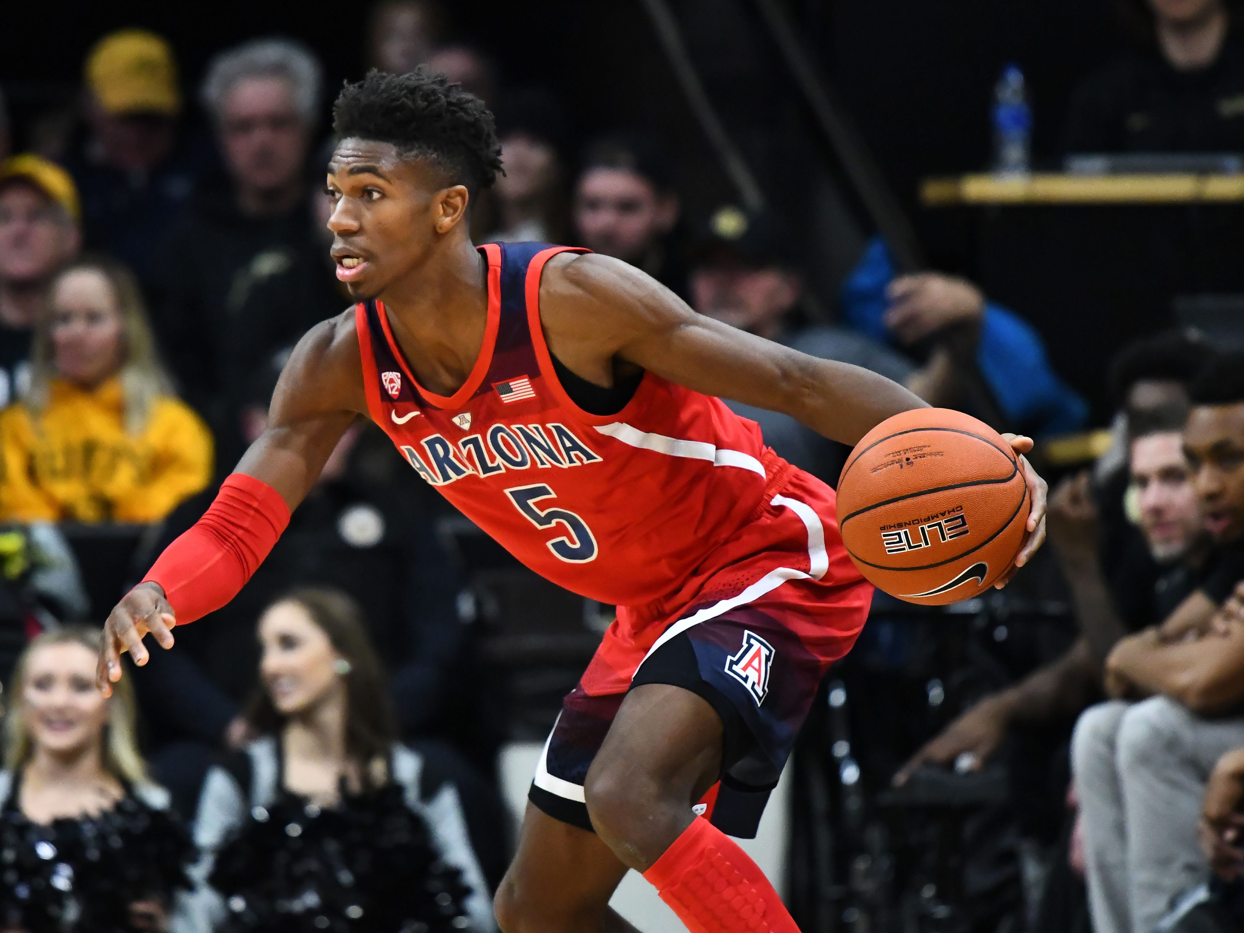 Feb 17, 2019; Boulder, CO, USA; Arizona Wildcats guard Brandon Randolph (5) controls the ball in the first half against the Colorado Buffaloes at the Coors Events Center. Mandatory Credit: Ron Chenoy-USA TODAY Sports