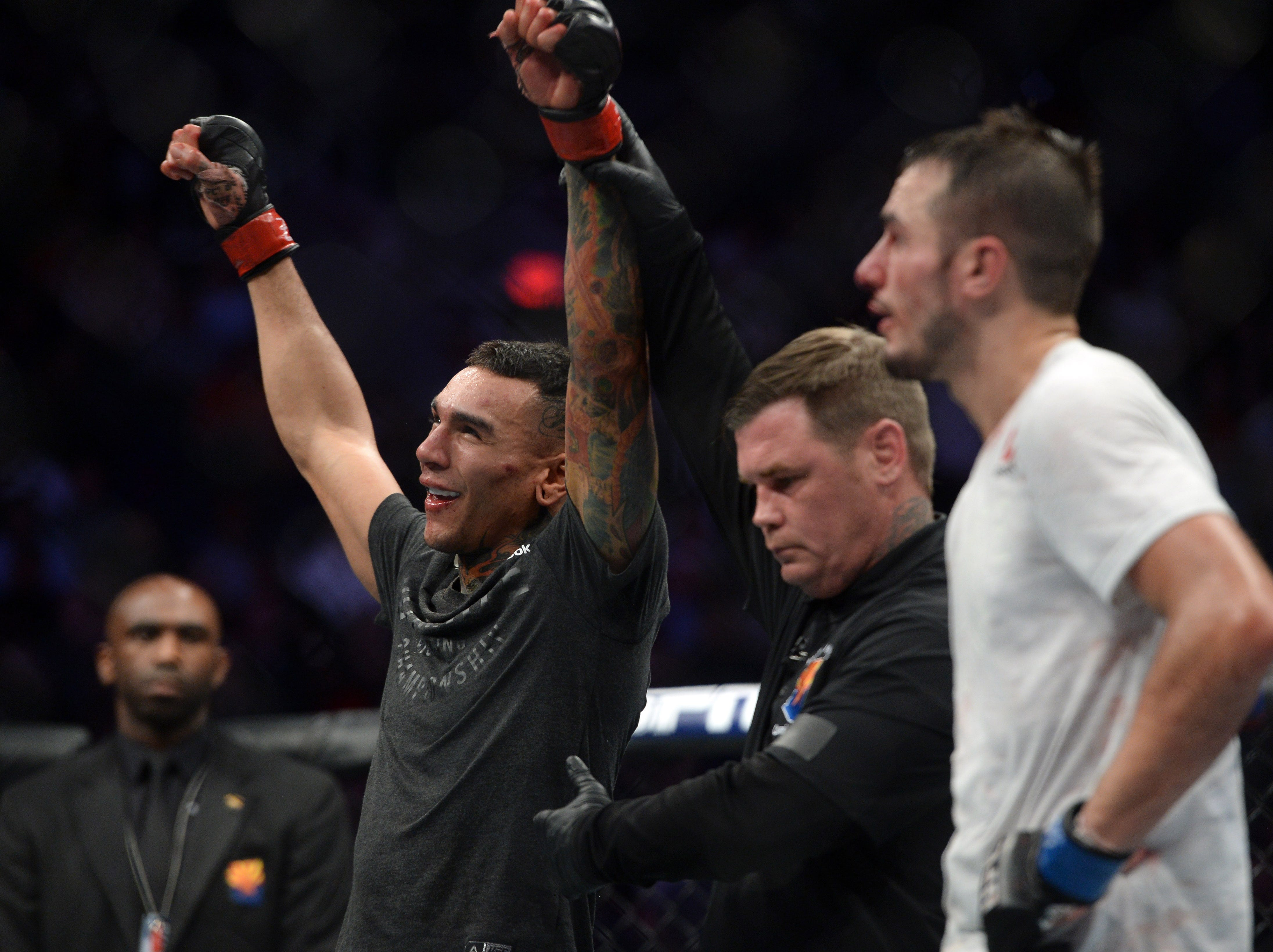 Feb 17, 2019; Phoenix, AZ, USA; Andre Fili (red) and Myles Jury (blue) react after their featherweight bout during UFC Fight Night at Talking Stick Resort Arena. Fili won via unanimous decision. Mandatory Credit: Joe Camporeale-USA TODAY Sports