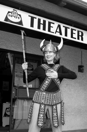 """Playwright and performer Terry Earp posed for an """"It ain't over"""" photo when she was forced to close her On the Spot Theater in 2003."""