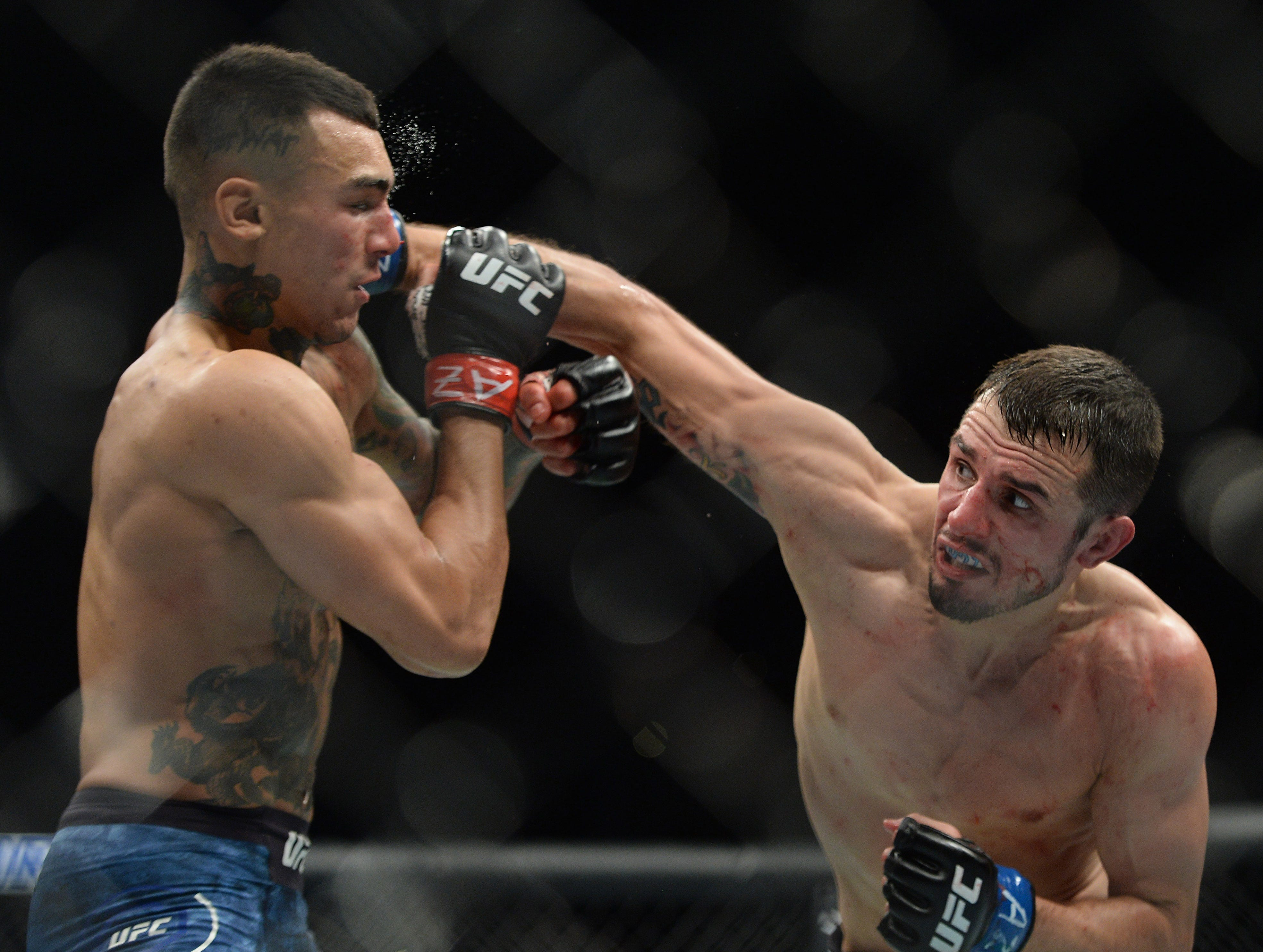 Myles Jury hits Andre Fili with a right hand during their featherweight bout at UFC Fight Night at Talking Stick Resort Arena. Fili won by unanimous decision.