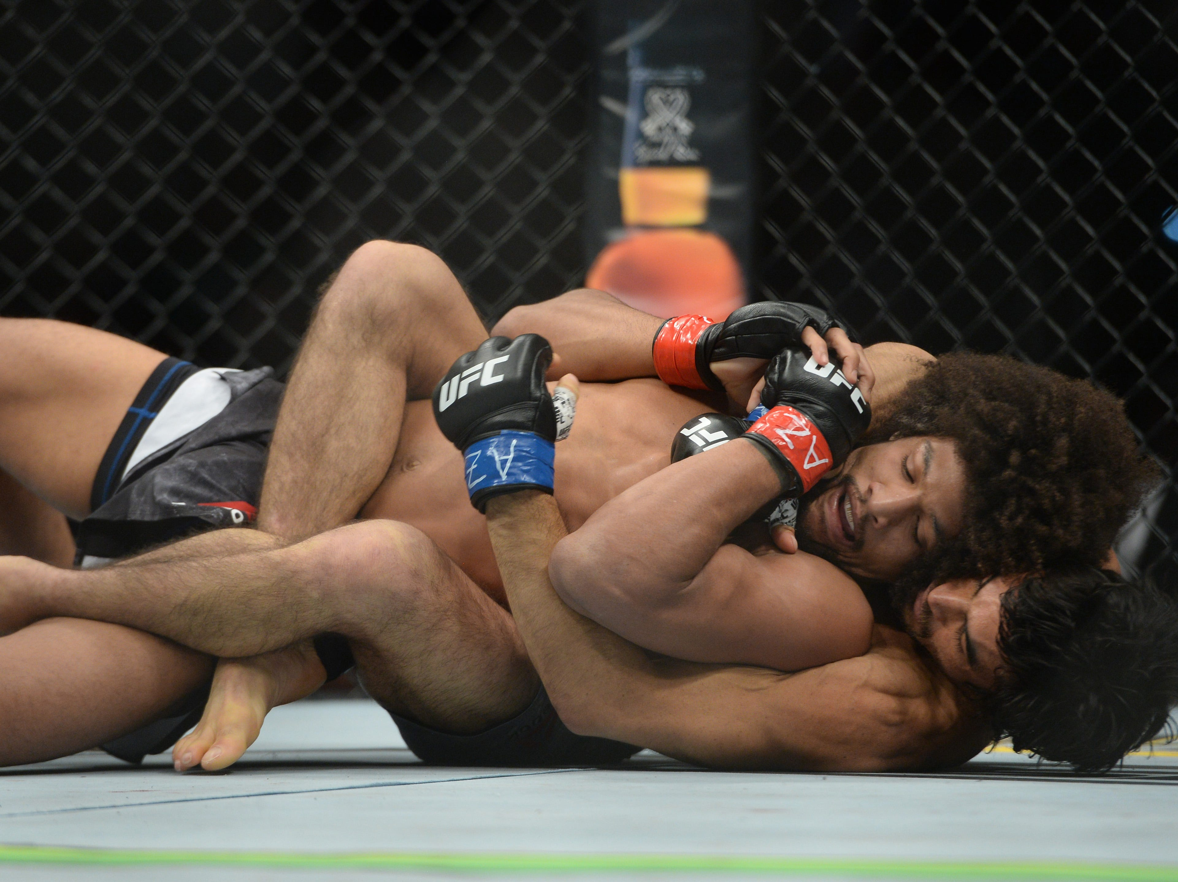 Kron Gracie wraps up Alex Caceres during their featherweight bout at UFC Fight Night at Talking Stick Resort Arena. Gracie won by submission in the first round.