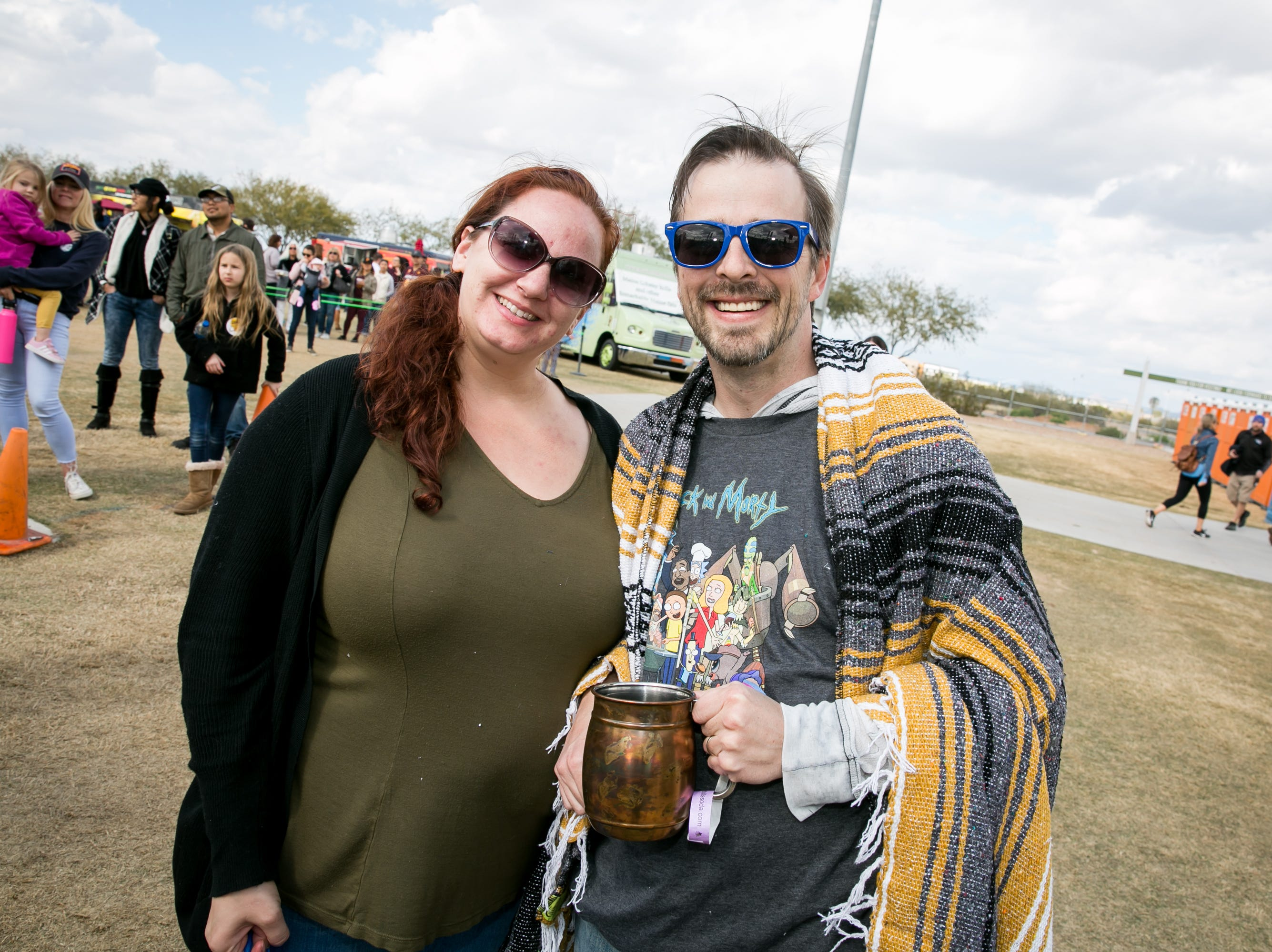 This couple stays warm during the Street Eats Food Truck Festival at Salt River Fields near Scottsdale on Feb. 17, 2019.