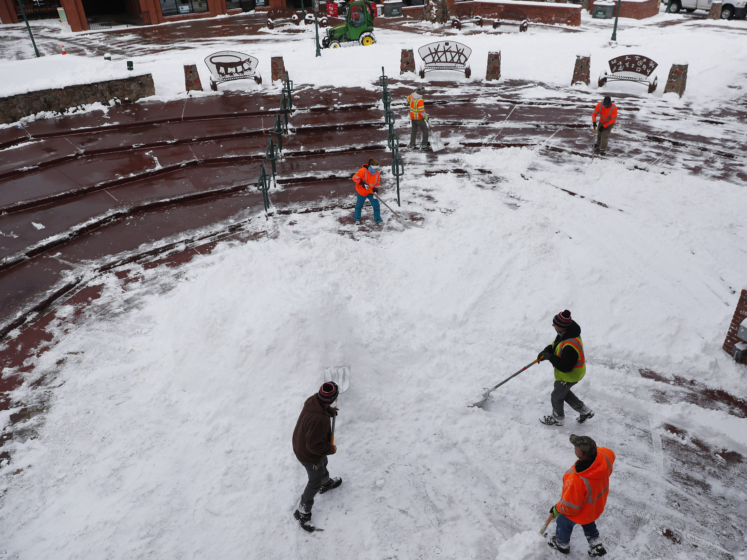 Workers clear snow from Heritage Square in Flagstaff Feb. 18, 2019.