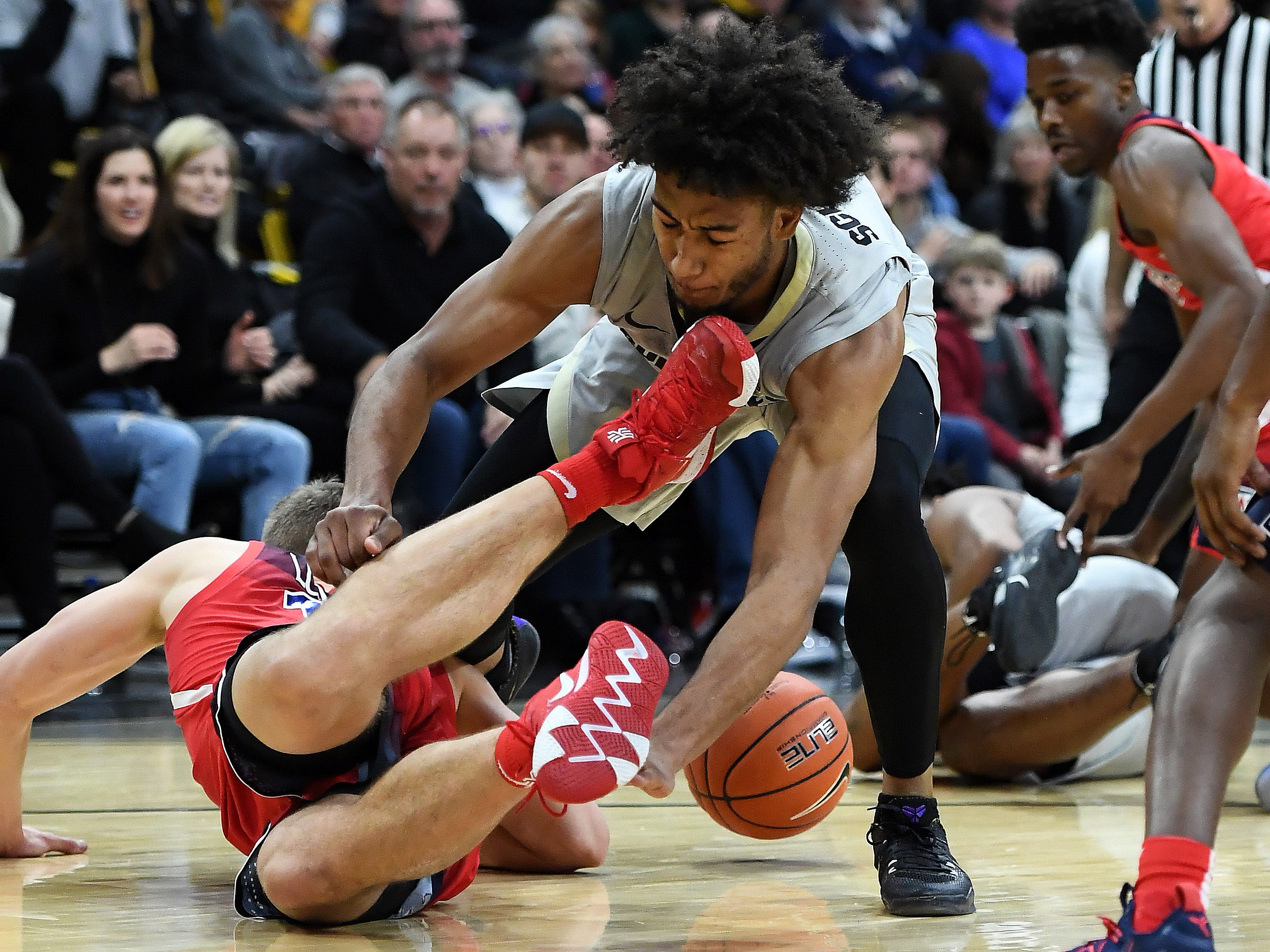 Feb 17, 2019; Boulder, CO, USA; Colorado Buffaloes guard D'Shawn Schwartz (5) dives for a loose ball and collides with Arizona Wildcats forward Ryan Luther (10) in the first half at the Coors Events Center. Mandatory Credit: Ron Chenoy-USA TODAY Sports