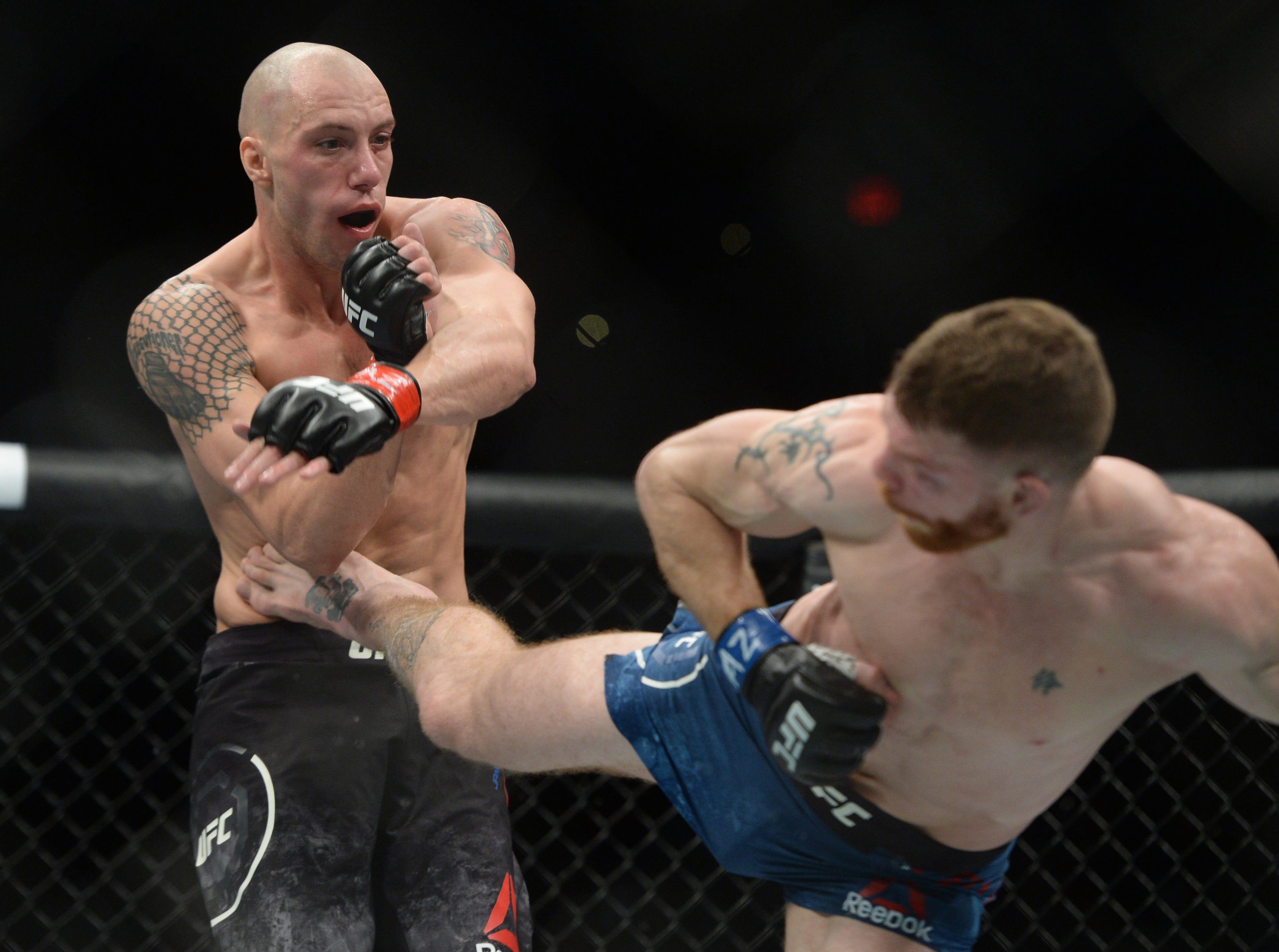Paul Felder kicks James Vick during their lightweight bout during UFC Fight Night at Talking Stick Resort Arena.