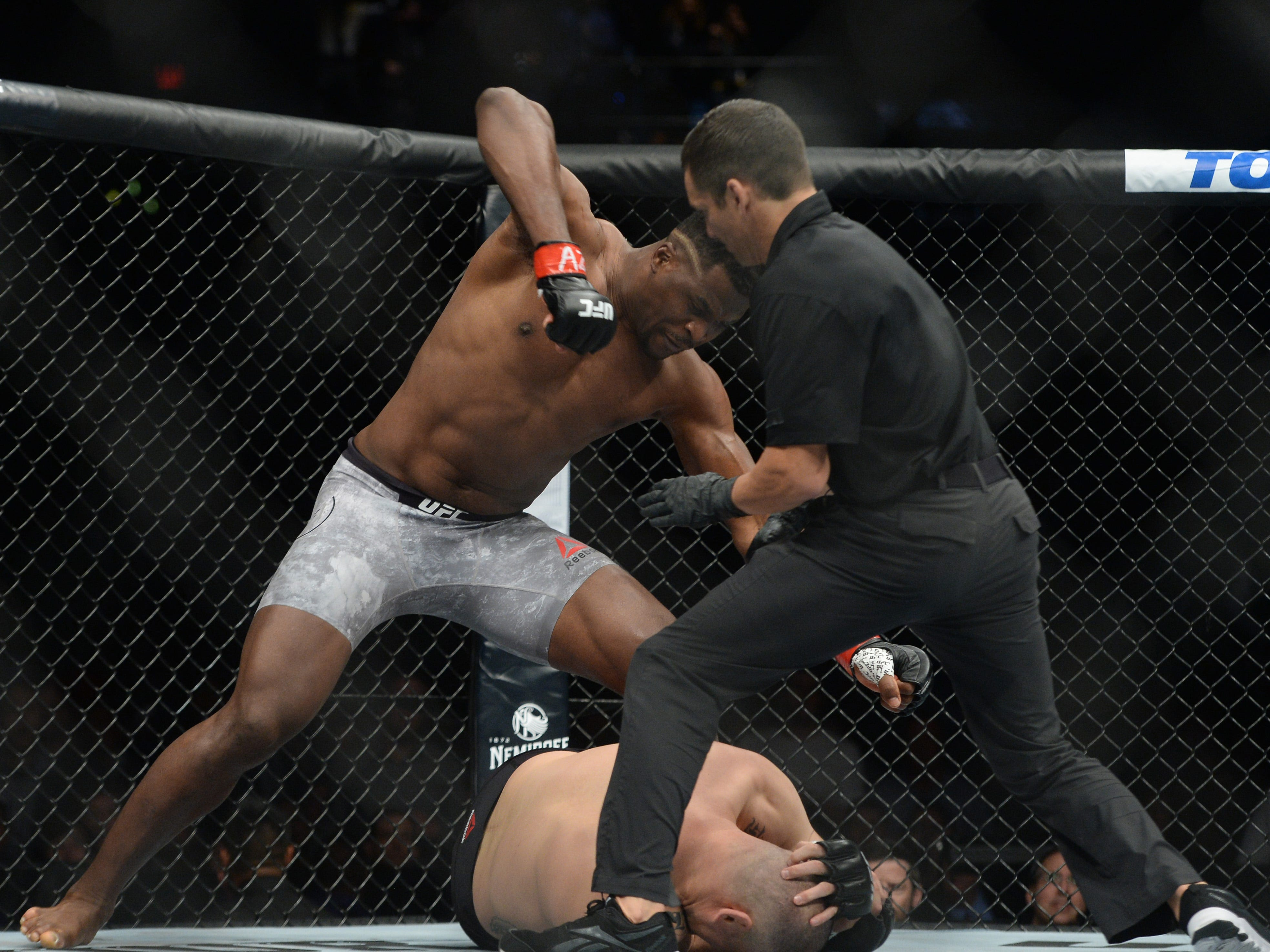 Francis Ngannou knocks out Cain Velasquez 26 seconds into their heavyweight fight at Talking Stick Resort Arena.