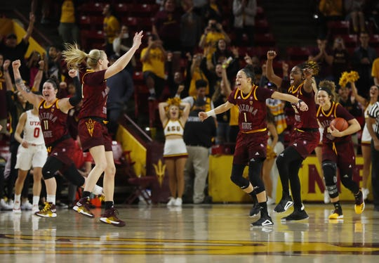 ASU's Reili Richardson (1), Courtney Ekmark (22), Kianna Ibis (42) and Charnea Johnson-Chapman (33) celebrate a come-from-behind win over Utah at Wells Fargo Arena in Tempe, Ariz. on February 17, 2019.