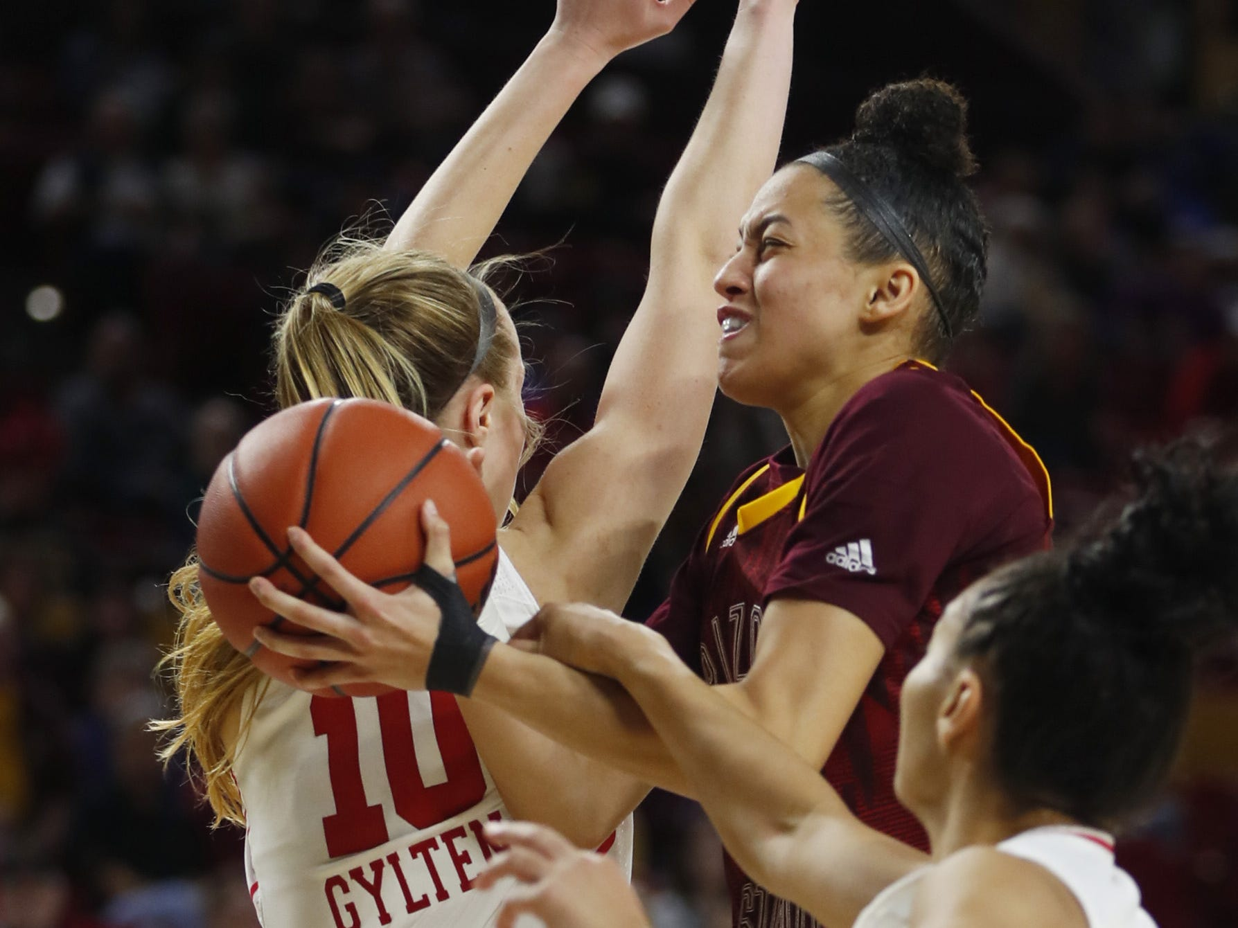 ASU's Reili Richardson (1) drives to the basket against Utah's Kiana Moore (0) during the second half at Wells Fargo Arena in Tempe, Ariz. on February 17, 2019.