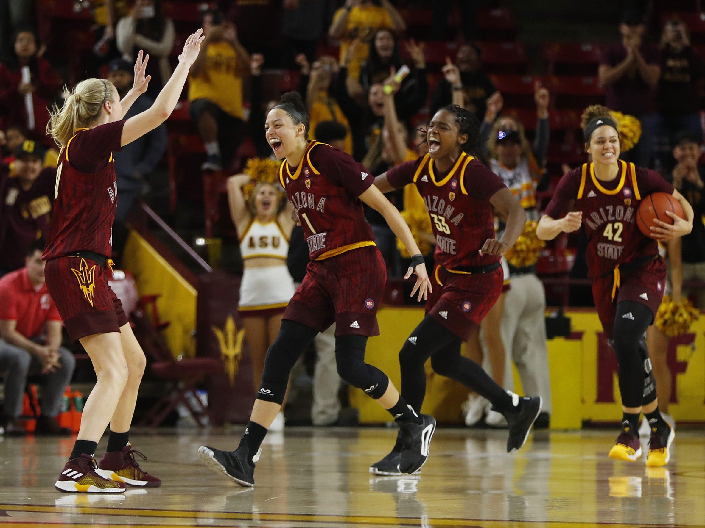 ASU's Reili Richardson (1), Courtney Ekmark (22), Kianna Ibis (42) and Charnea Johnson-Chapman (33) celebrate a come-from-behind win over Utah at Wells Fargo Arena in Tempe, Ariz. on February 17, 2019.