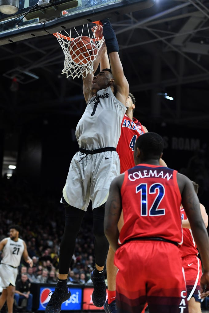 Feb 17, 2019: Colorado Buffaloes guard Tyler Bey (1) shoots past Arizona Wildcats center Chase Jeter (4) in the first half at the Coors Events Center.