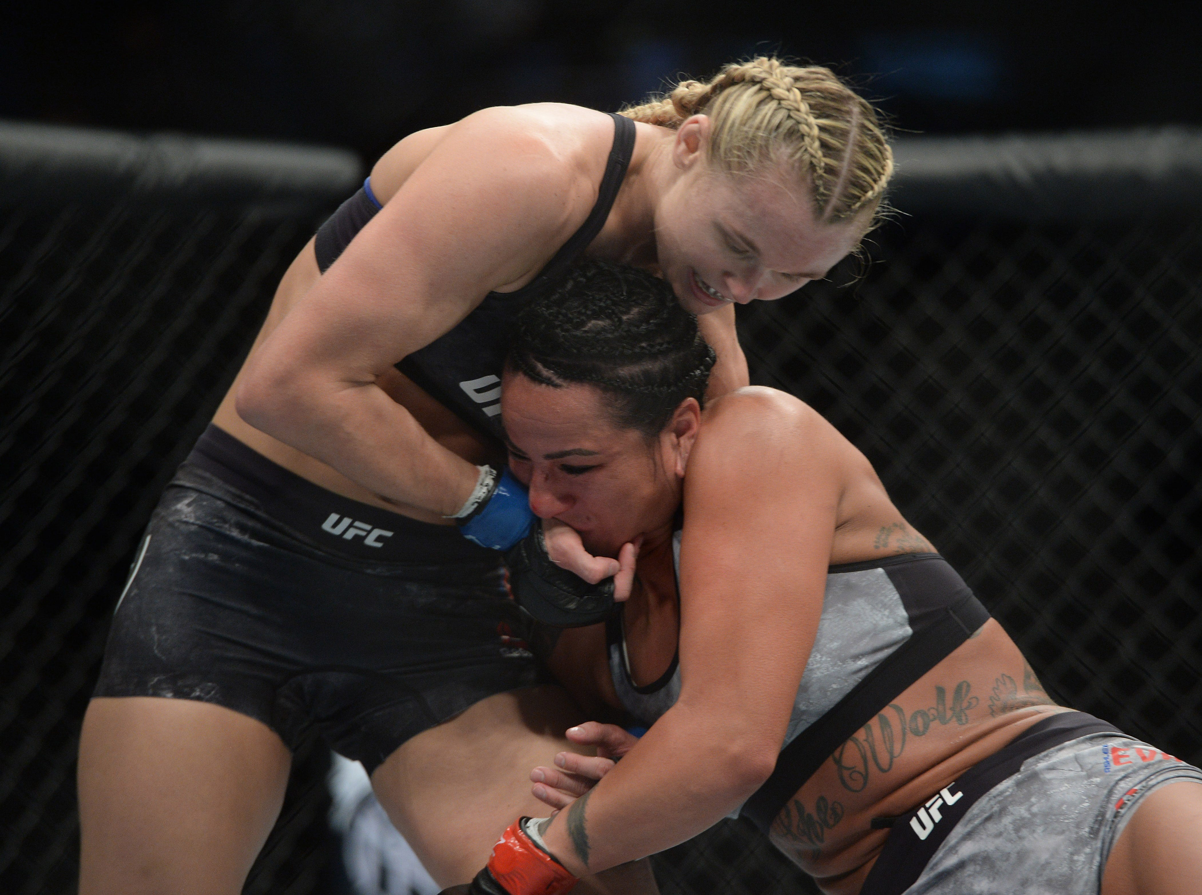 Andre Lee and Ashlee Evans-Smith, right tangle during their flyweight bout during UFC Fight Night at Talking Stick Resort Arena. Lee won by decision.