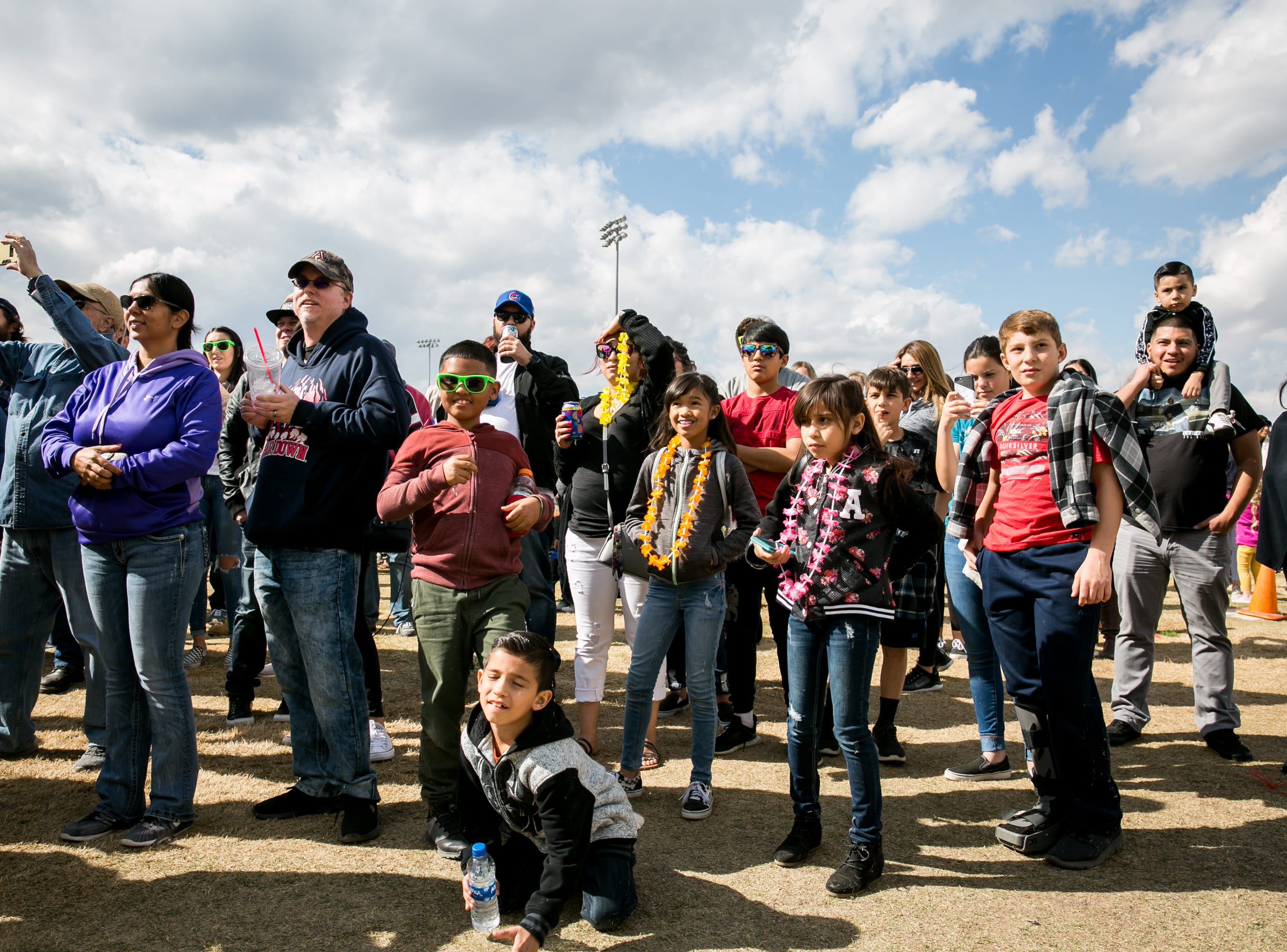 The crowd watches the eating contest during the Street Eats Food Truck Festival at Salt River Fields near Scottsdale on Feb. 17, 2019.