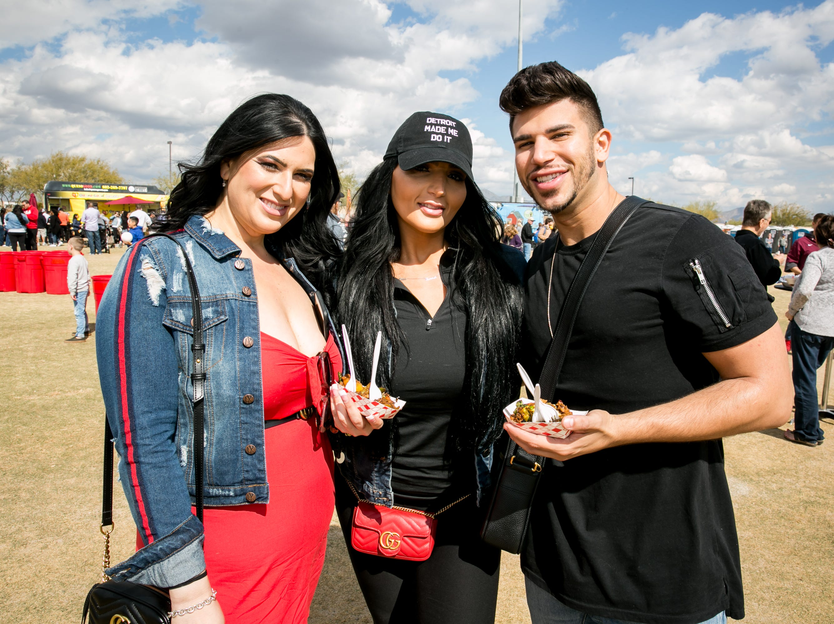 Detroit made this trio have a blast during the Street Eats Food Truck Festival at Salt River Fields near Scottsdale on Feb. 17, 2019.