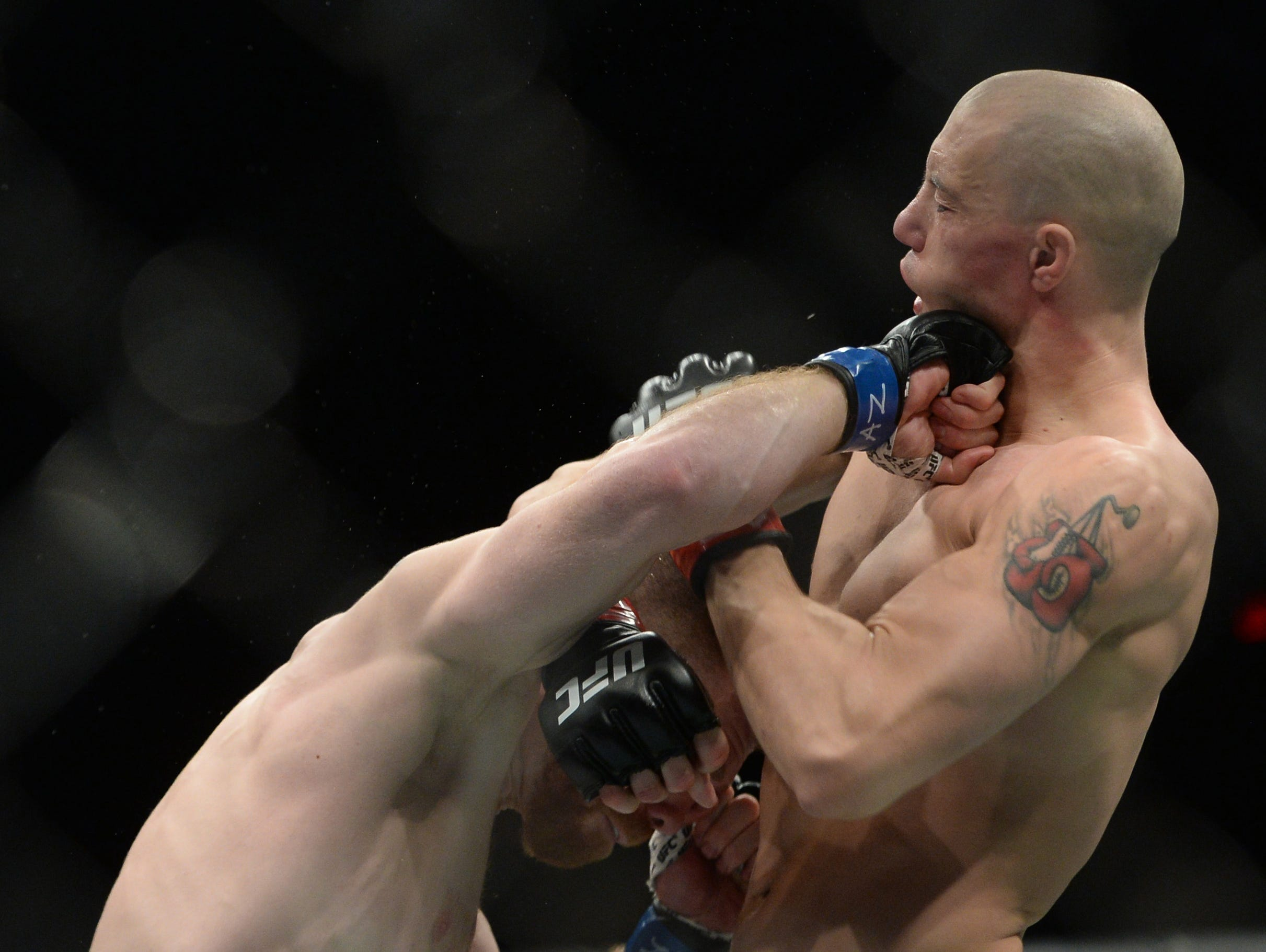 Paul Felder connects with a right hand on James Vick during their lightweight fight at UFC on ESPN at Talking Stick Resort Arena. Felder won by unanimous decision.