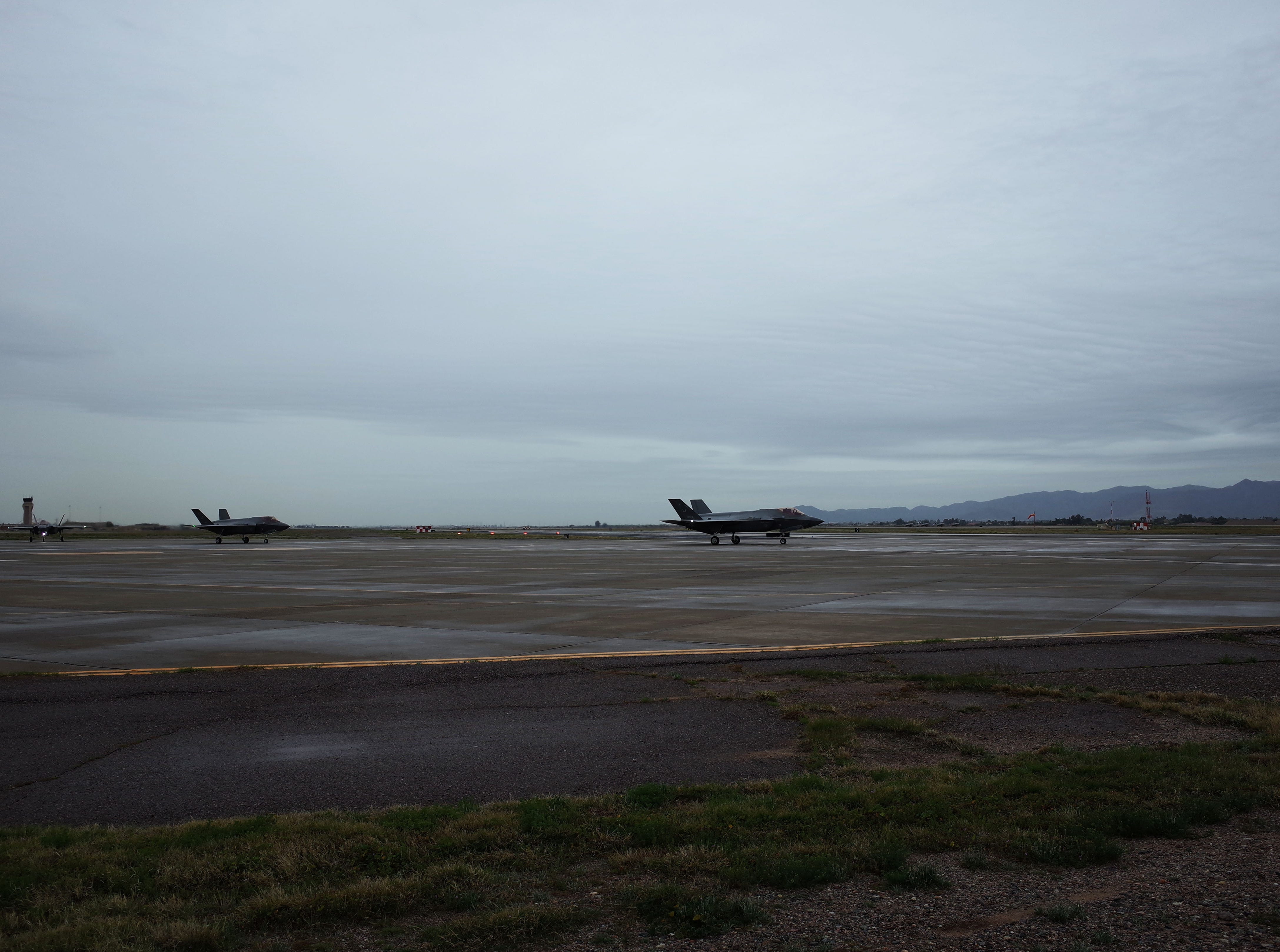 F-35s taxi for takeoff at Luke Air Force Base in Glendale, the White Tank Mountains in the backdrop, in February 2019.  The model of the F-35A made for the the Air Force can support an internal cannon, according to Lockheed Martin.
