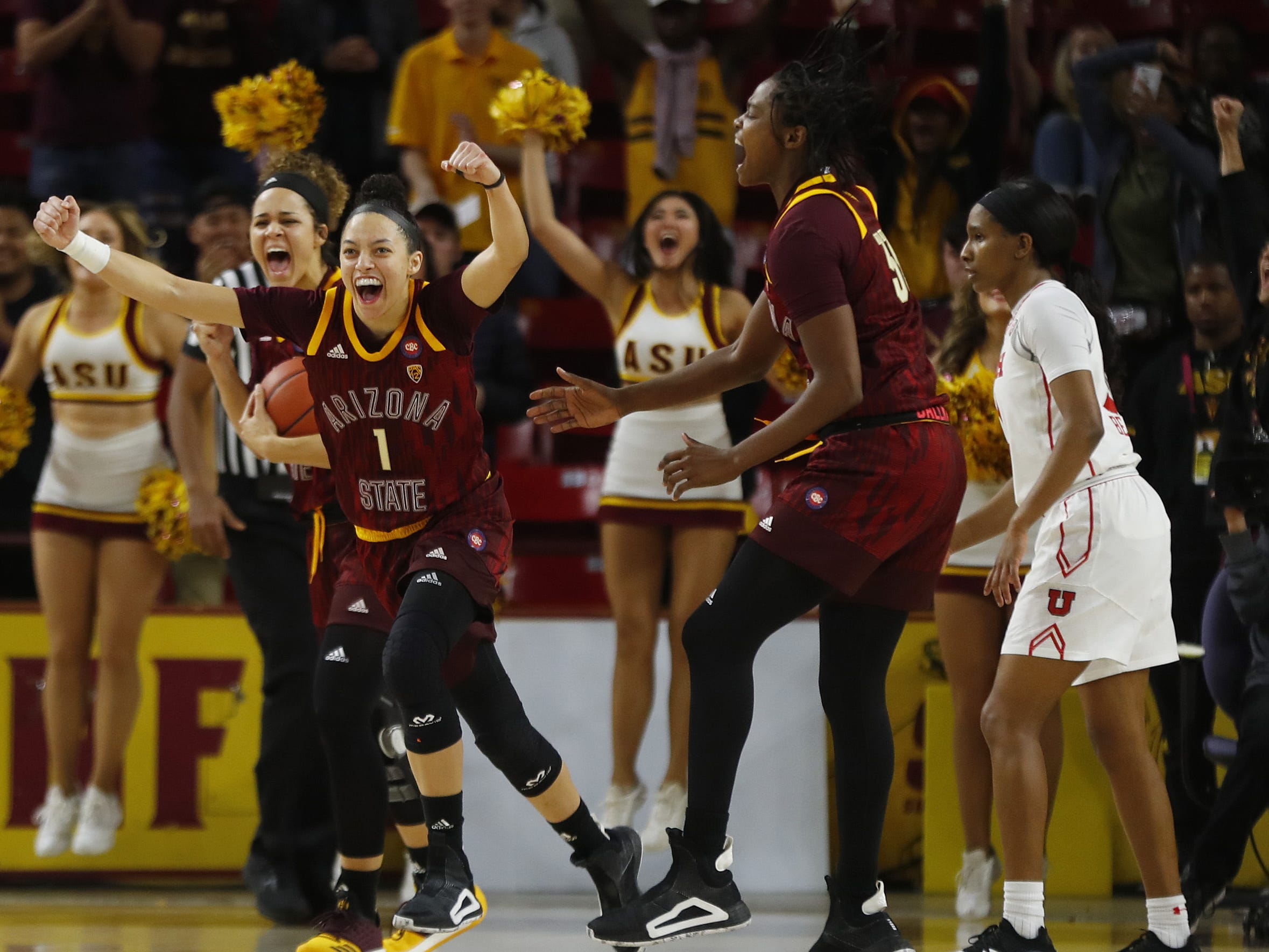 ASU's Reili Richardson (1), Kianna Ibis (42) and Charnea Johnson-Chapman (33) celebrate a come-from-behind win over Utah at Wells Fargo Arena in Tempe, Ariz. on February 17, 2019.