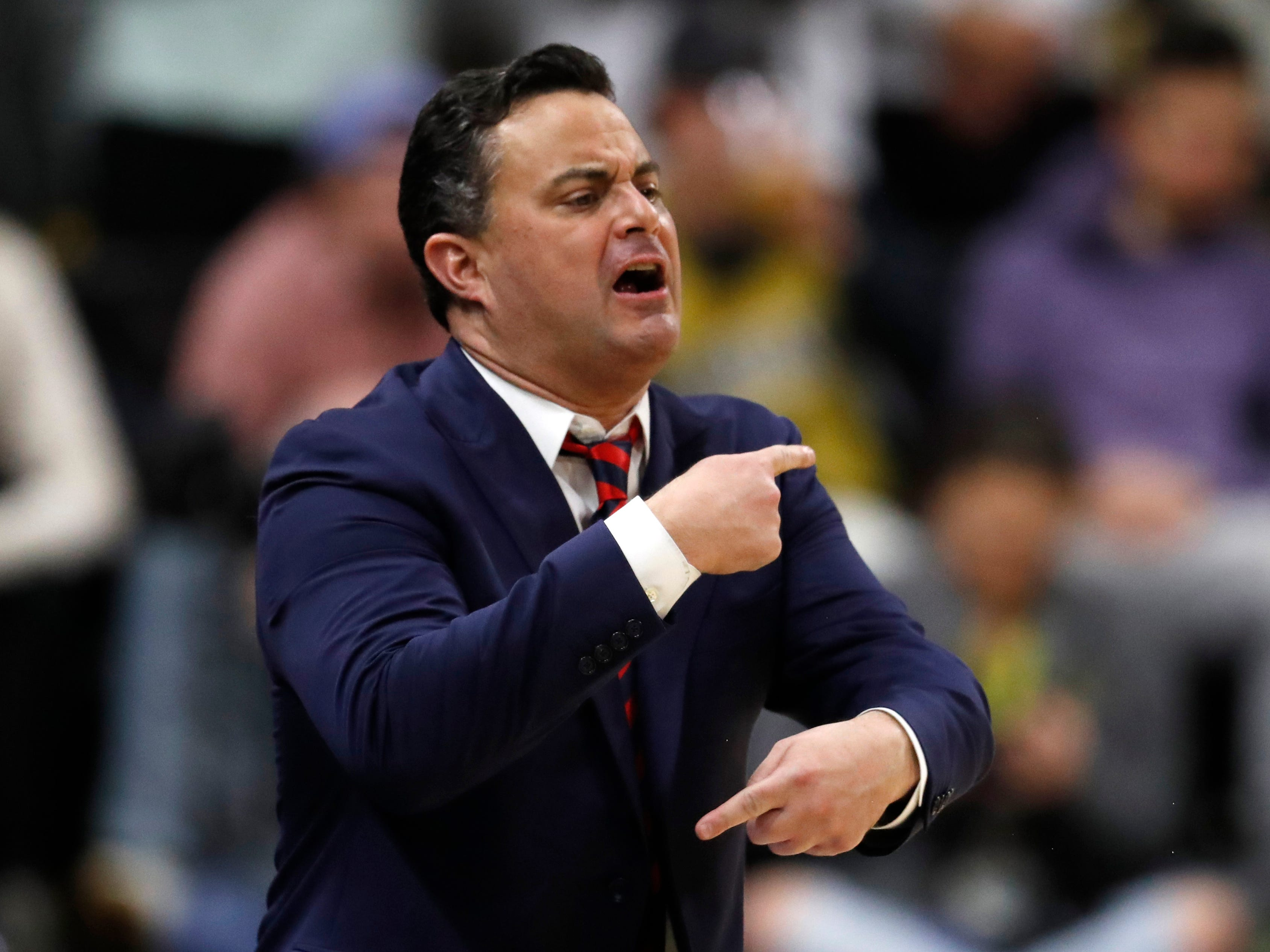Arizona head coach Sean Miller directs his team against Colorado in the first half of an NCAA college basketball game Sunday, Feb. 17, 2019, in Boulder, Colo.