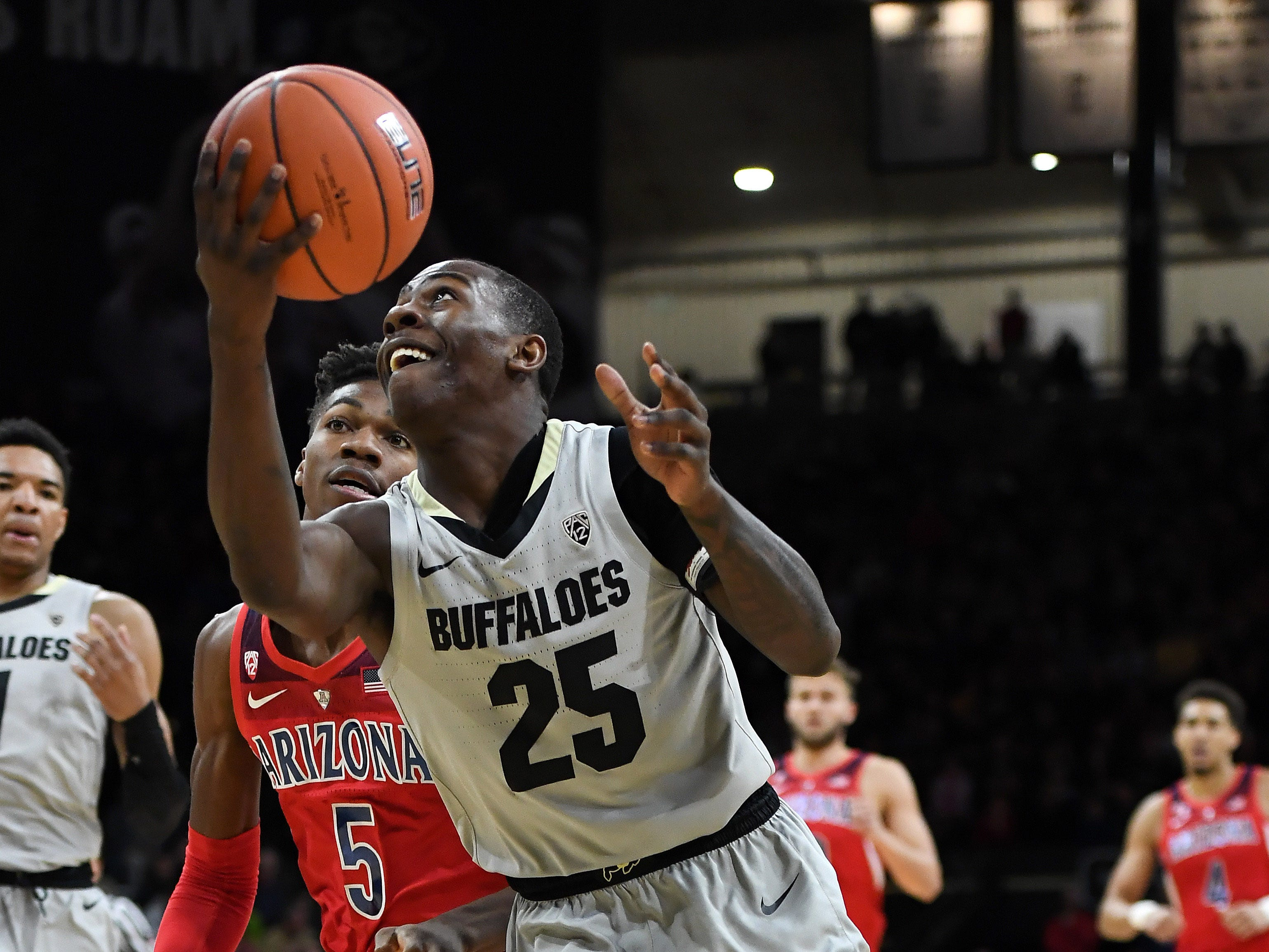 Feb 17, 2019; Boulder, CO, USA; Colorado Buffaloes guard McKinley Wright IV (25) shoots past Arizona Wildcats guard Brandon Randolph (5) in the first half at the Coors Events Center. Mandatory Credit: Ron Chenoy-USA TODAY Sports
