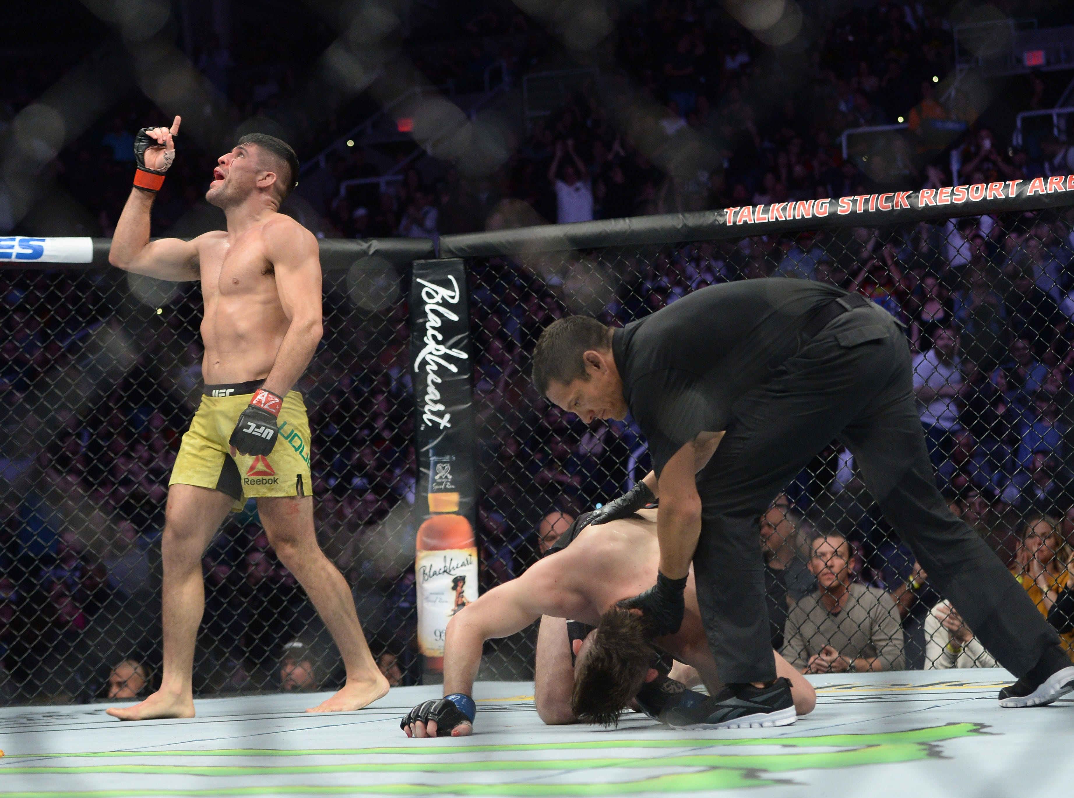 Feb 17, 2019; Phoenix, AZ, USA; Vicente Luque (red) finishes Bryan Barberena (blue) during their welterweight bout during UFC Fight Night at Talking Stick Resort Arena. Luque won via third round TKO. Mandatory Credit: Joe Camporeale-USA TODAY Sports