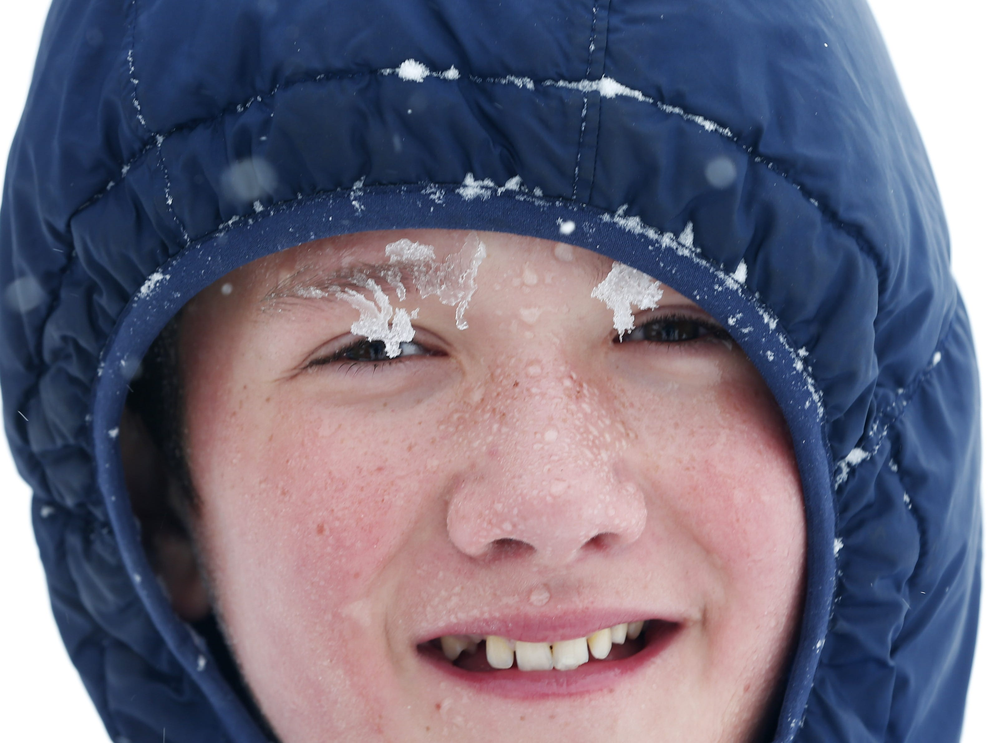 Micah Rhon, 11, is covered in snow in Flagstaff Feb. 18, 2019.