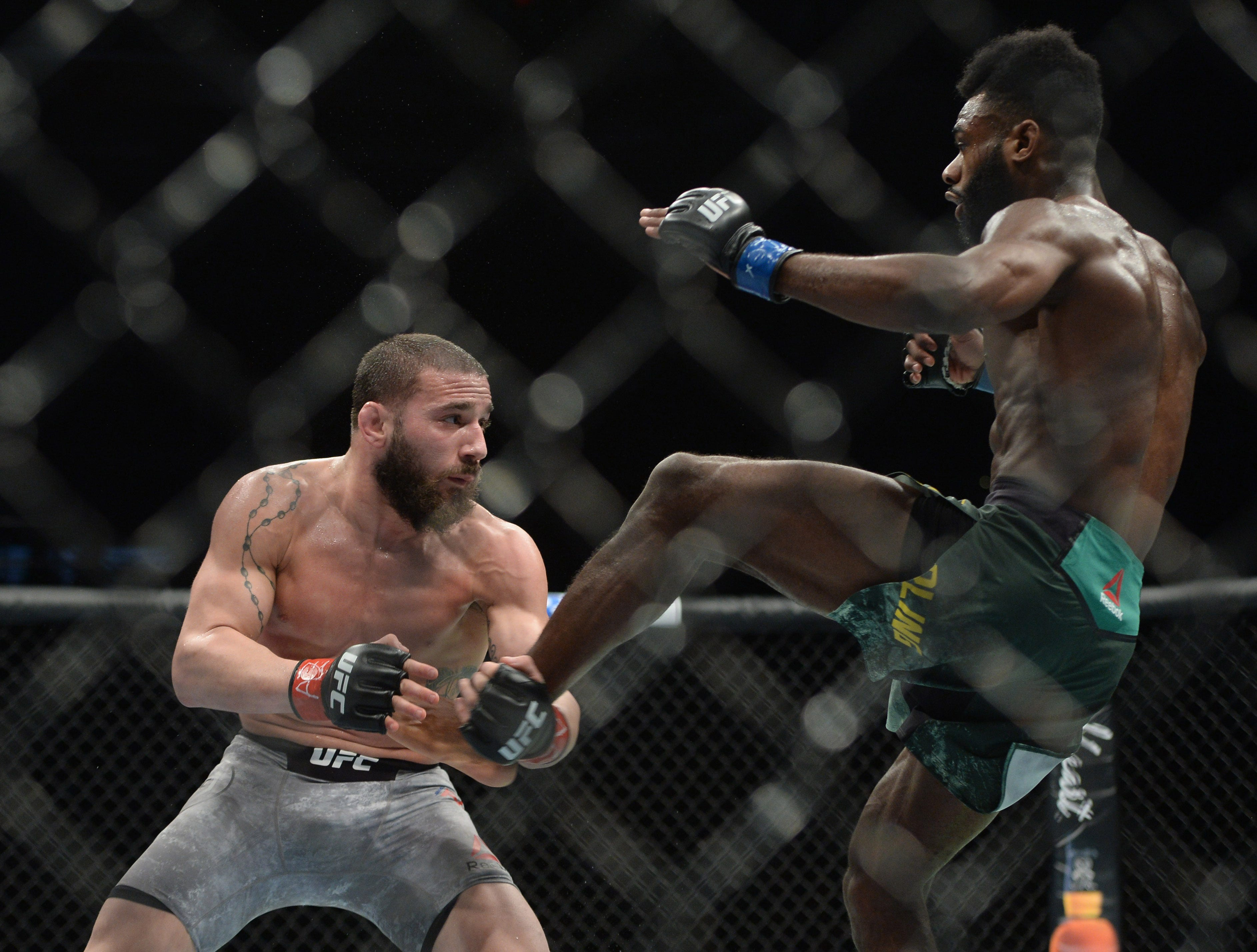 Jimmie Rivera catches Aljamain Sterling's leg during their bantamweight fight atUFC Fight Night at Talking Stick Resort Arena. Sterling won via unanimous decision.